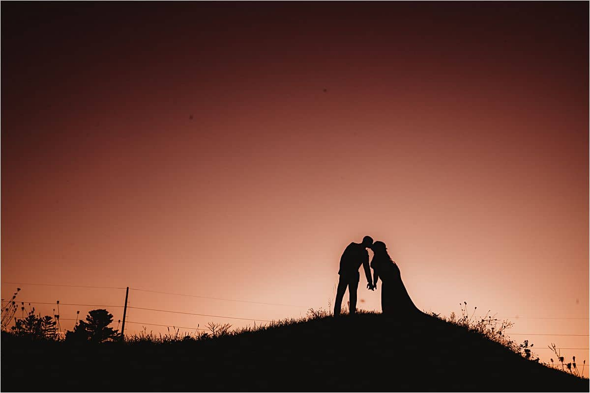 Bride and Groom Kissing Post Sunset