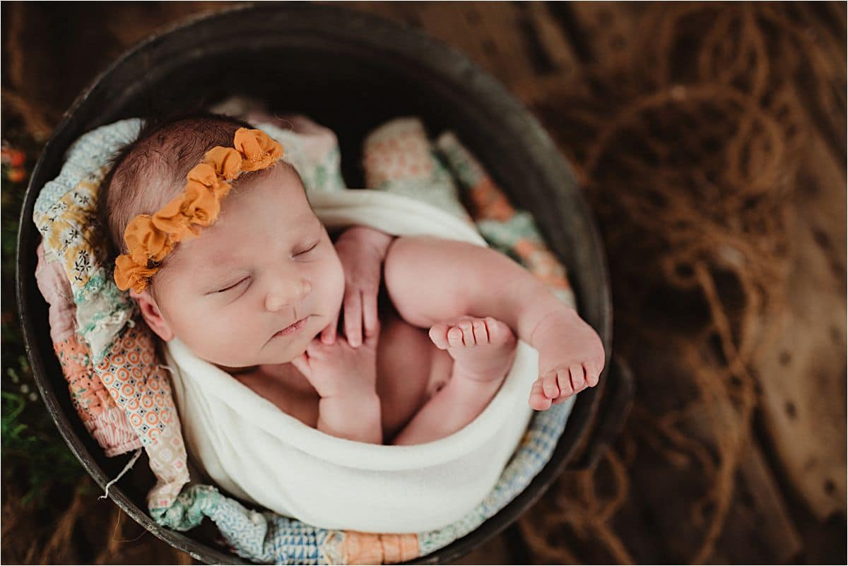 Newborn Girl in Bucket Orange Headband