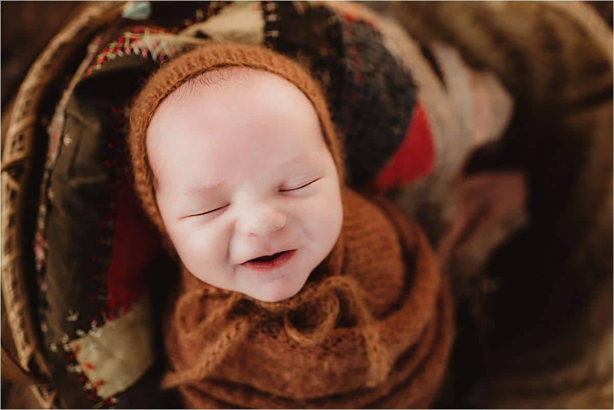 Newborn Boy Brown Bonnet Smiling