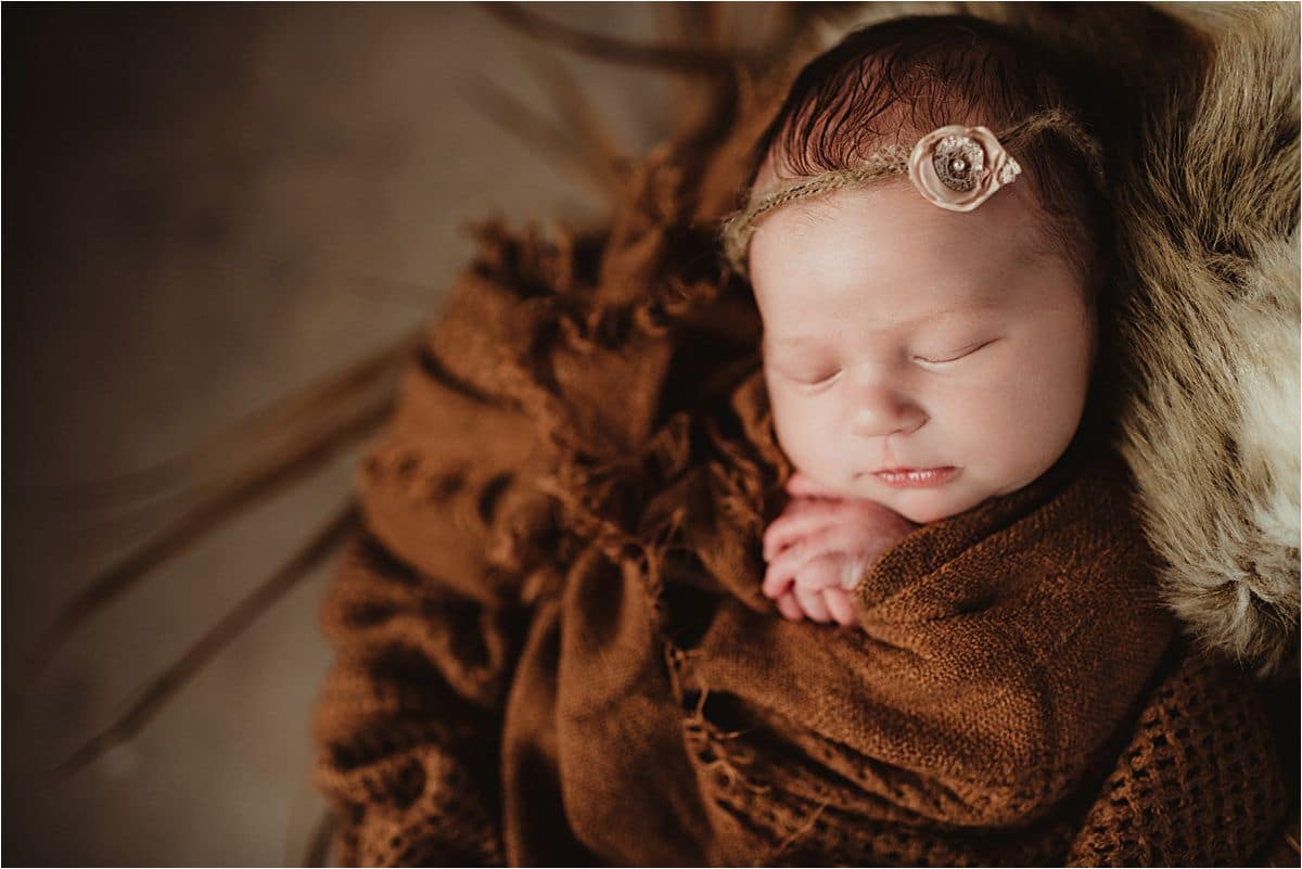 Close Up Newborn Girl in Brown Wrap
