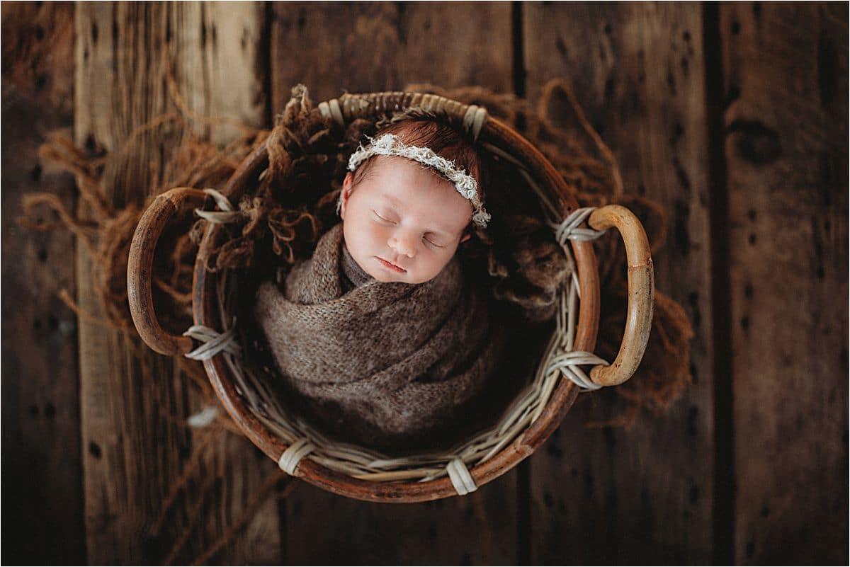 Newborn Girl Wrapped in Basket
