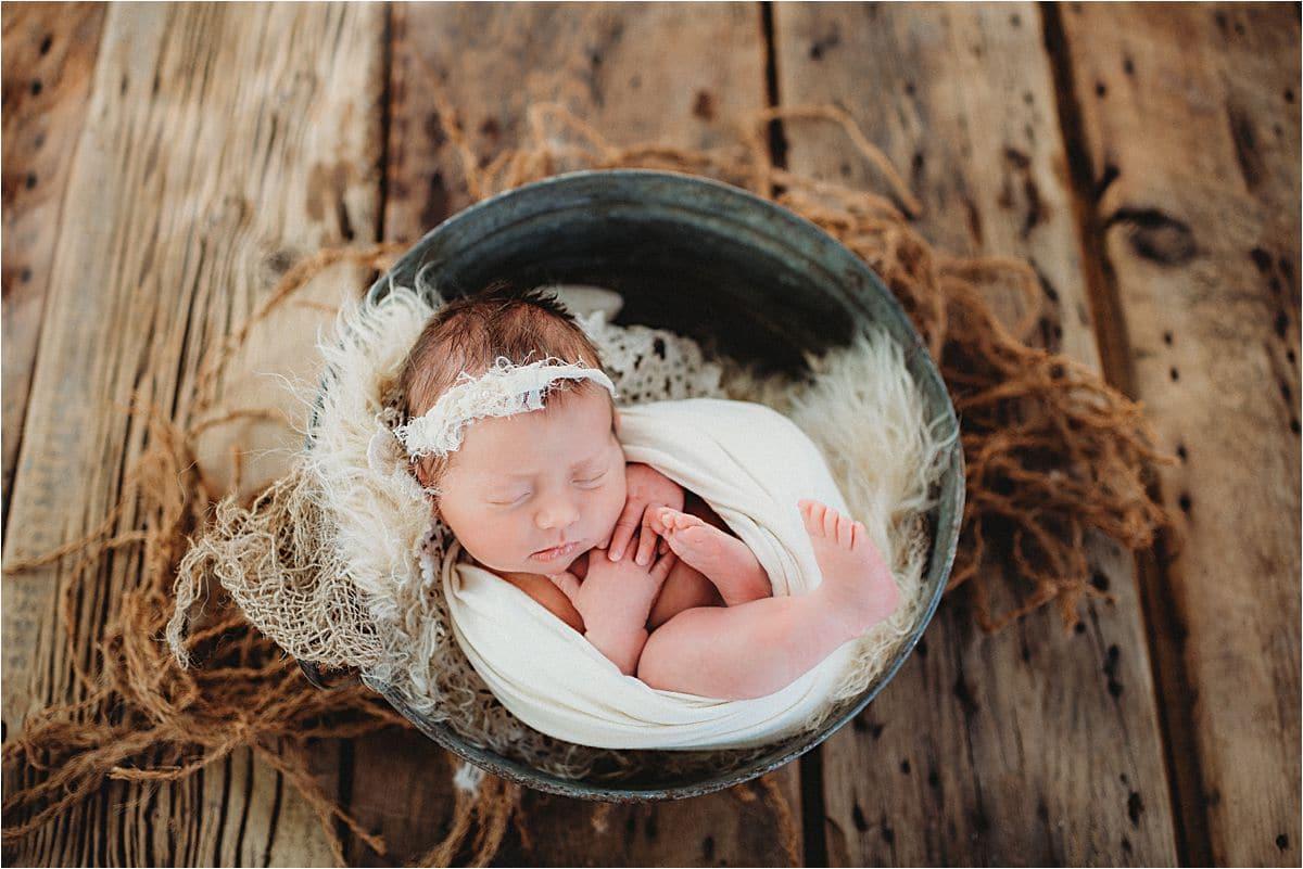 Newborn Girl in Metal Bucket