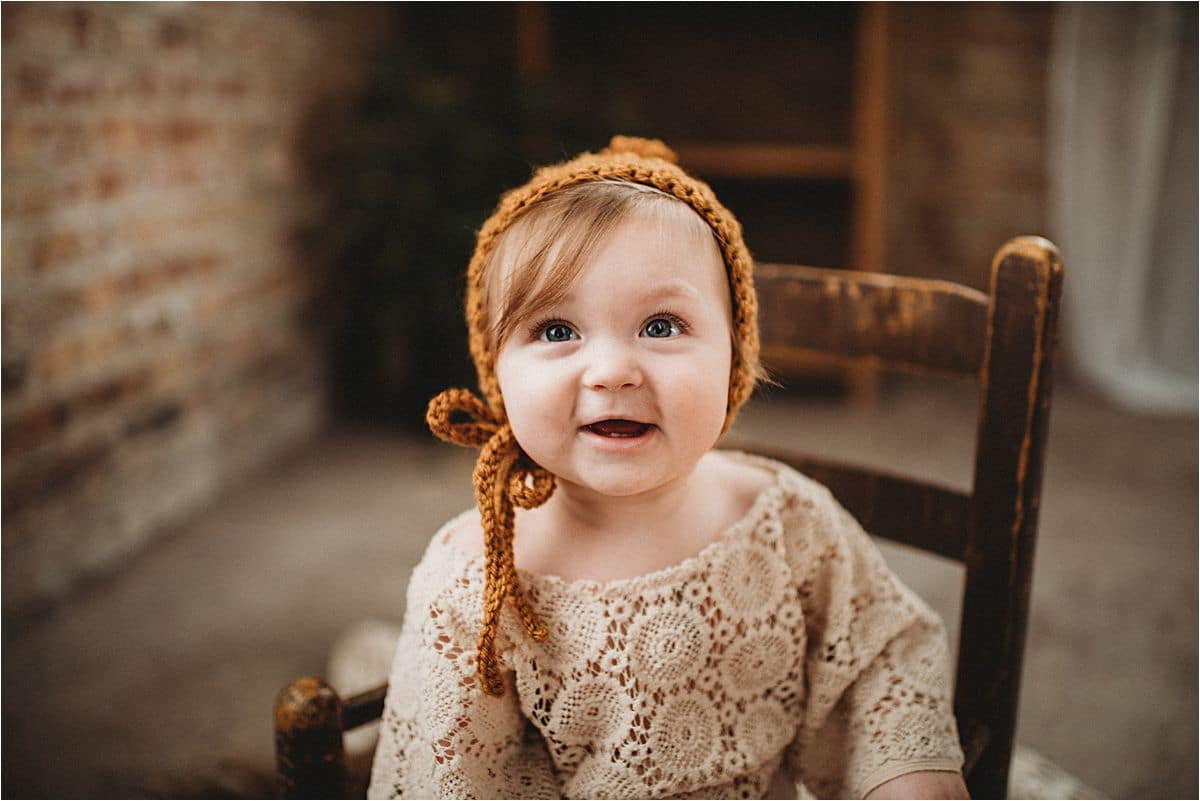 Close Up of Little Girl in Bonnet Smiling