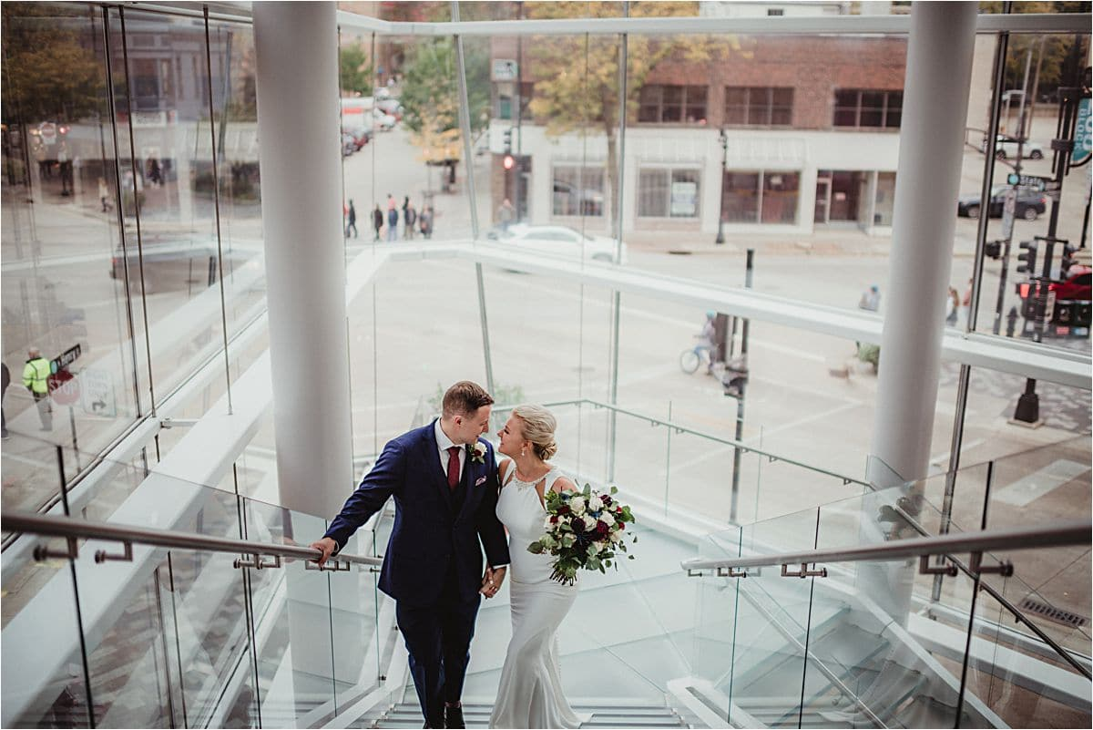 Bride and Groom in Front of Glass Walls