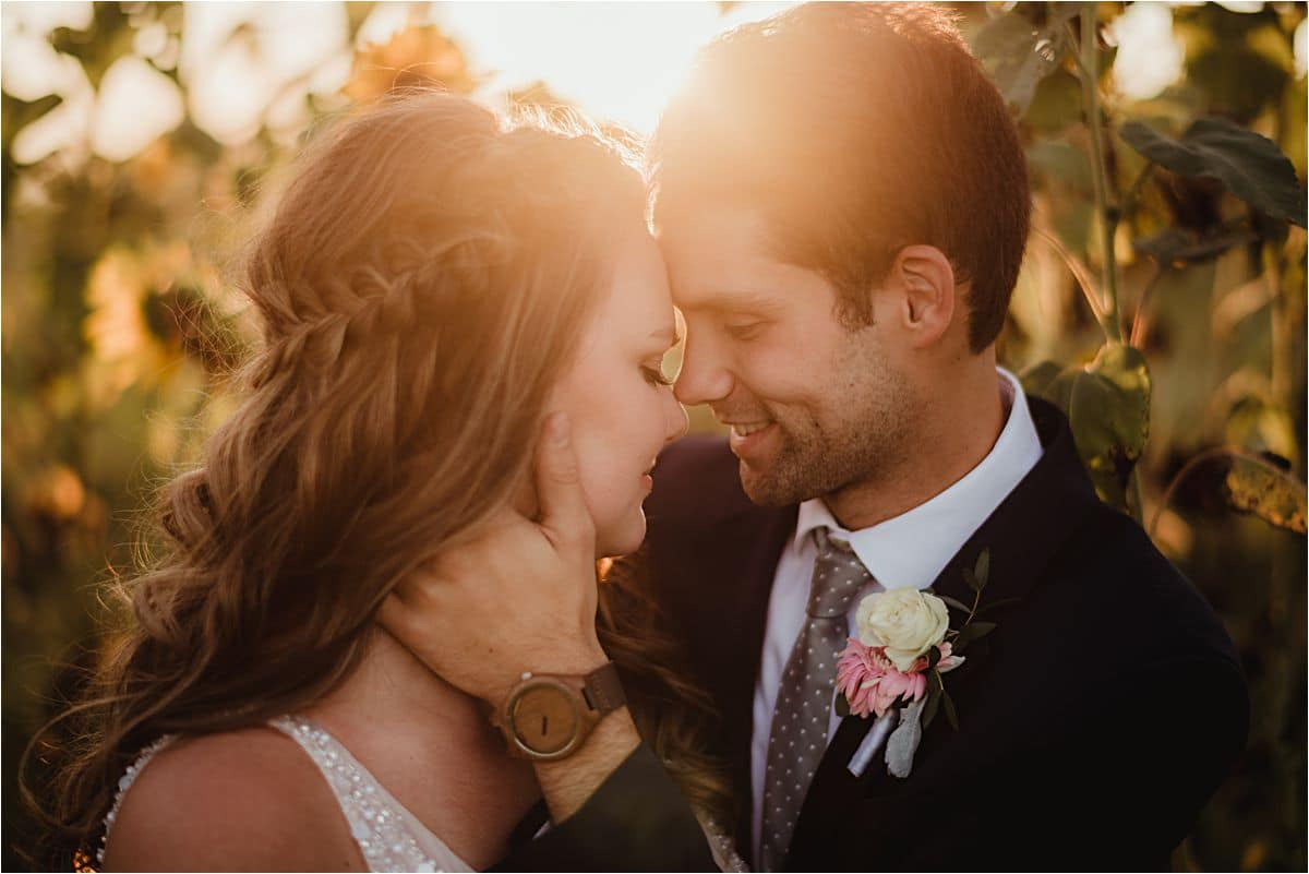 Groom Holding Bride's Face