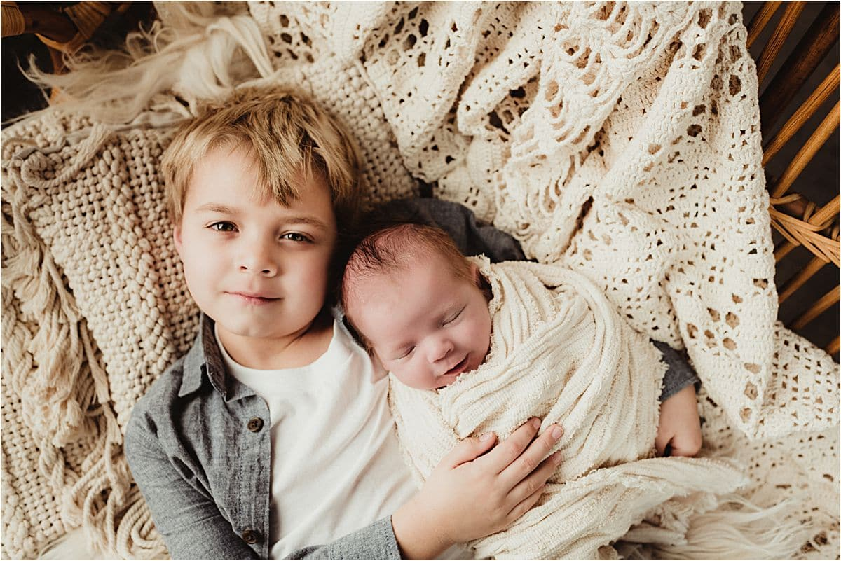 Brother with Newborn Boy