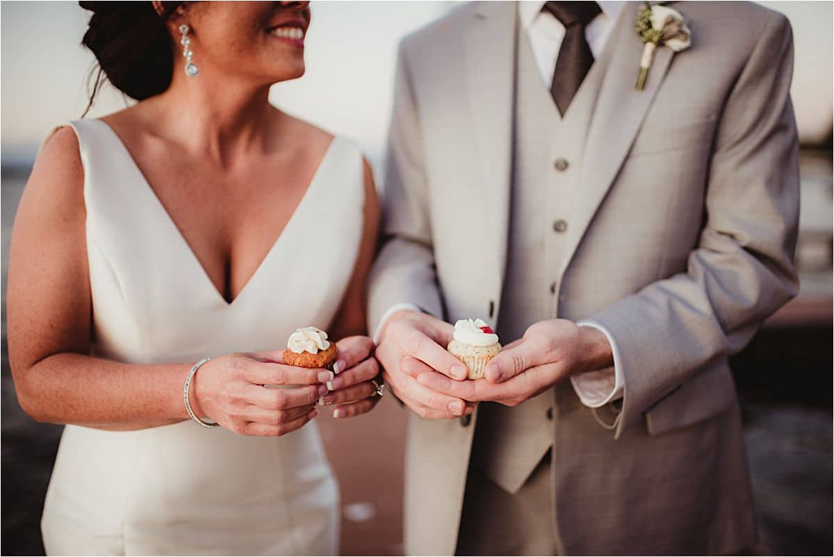 Bride and Groom Holding Mini Cupcakes