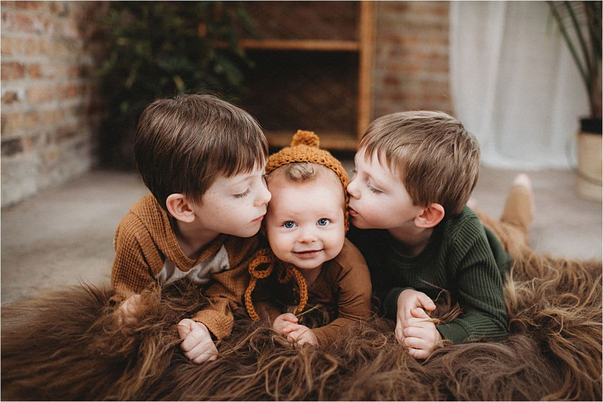 Brothers Kissing Baby Brother