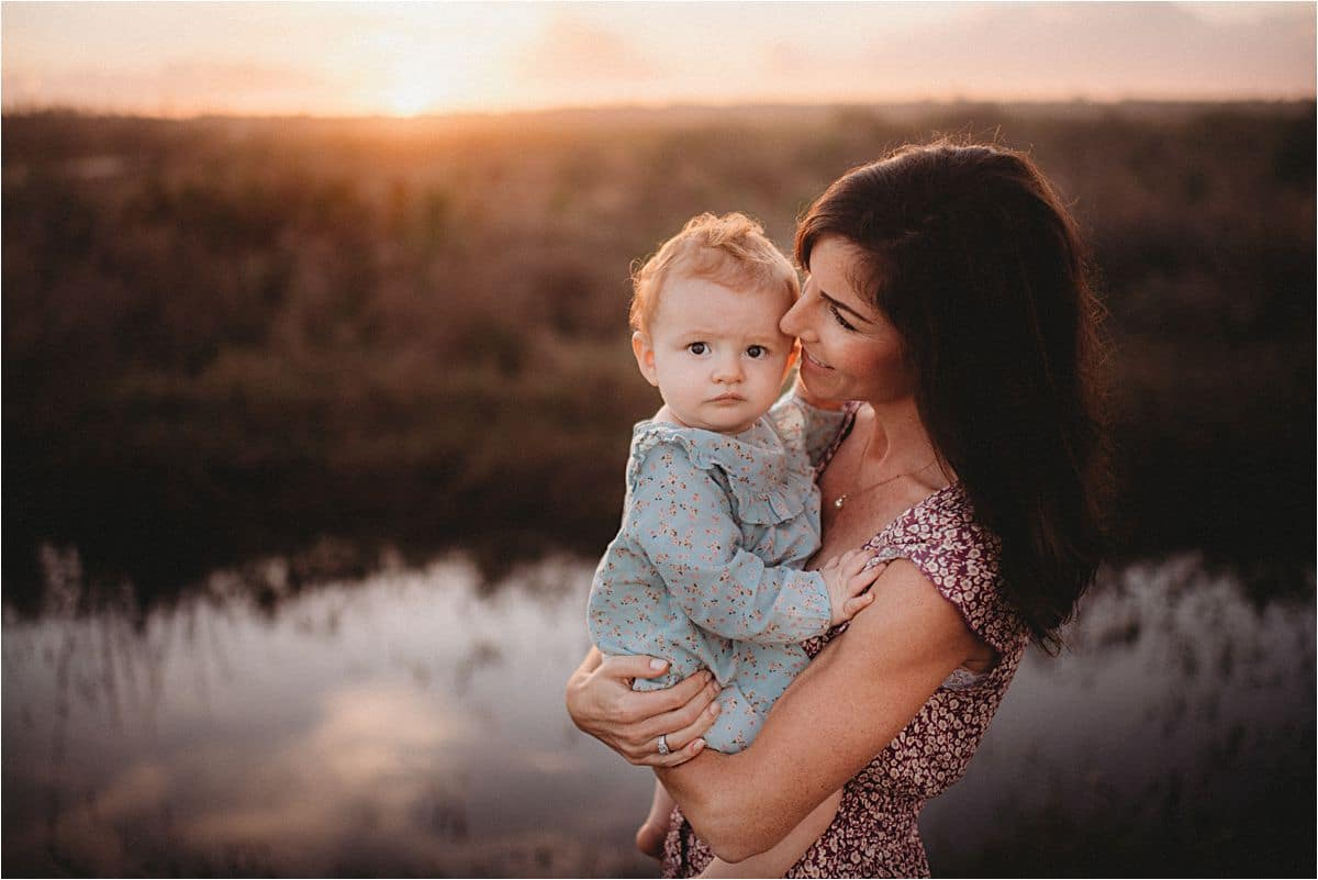 Mom Kissing Daughter at Sunset
