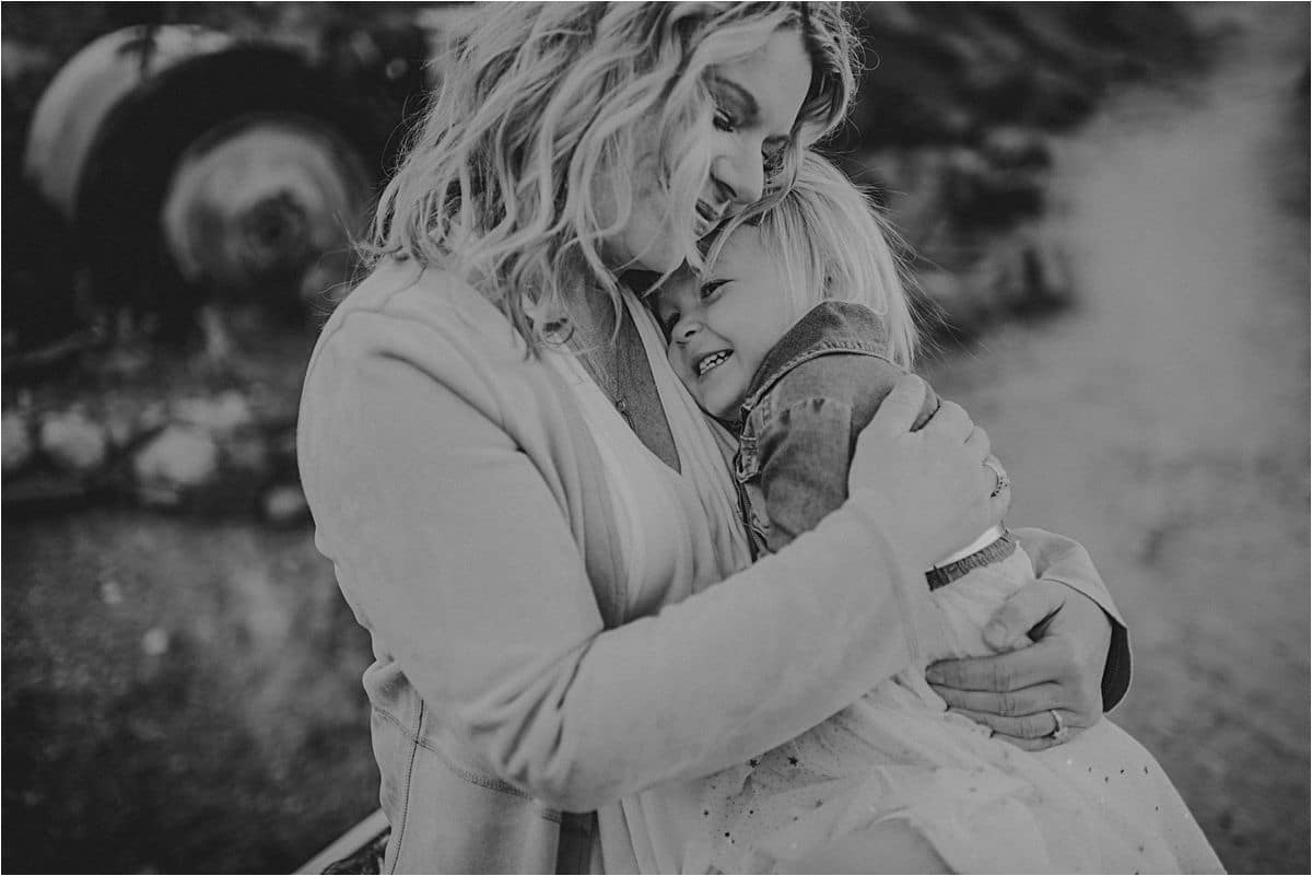 Black and White Image of Mom and Daughter Hugging