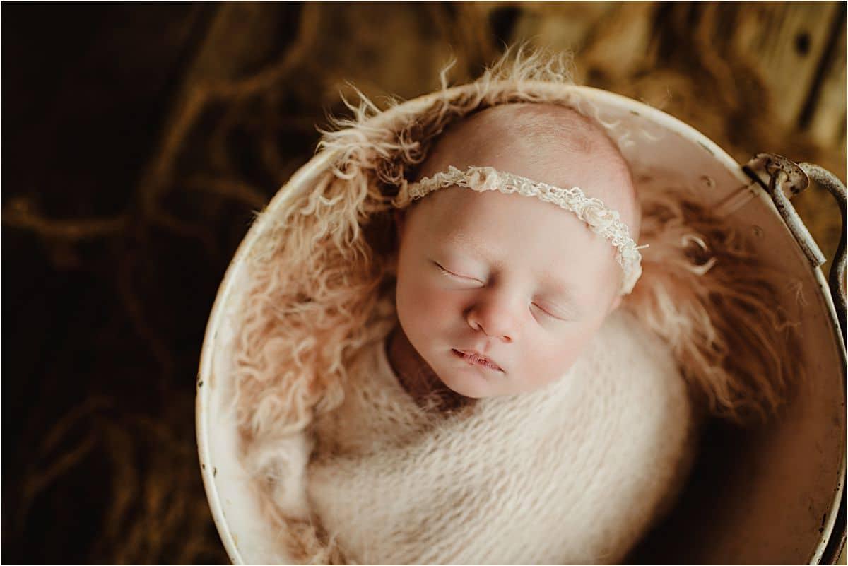 Newborn Girl in Pink Bowl