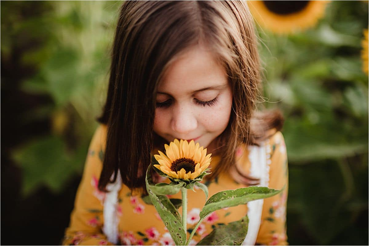 Close Up Girl Smelling Sunflower