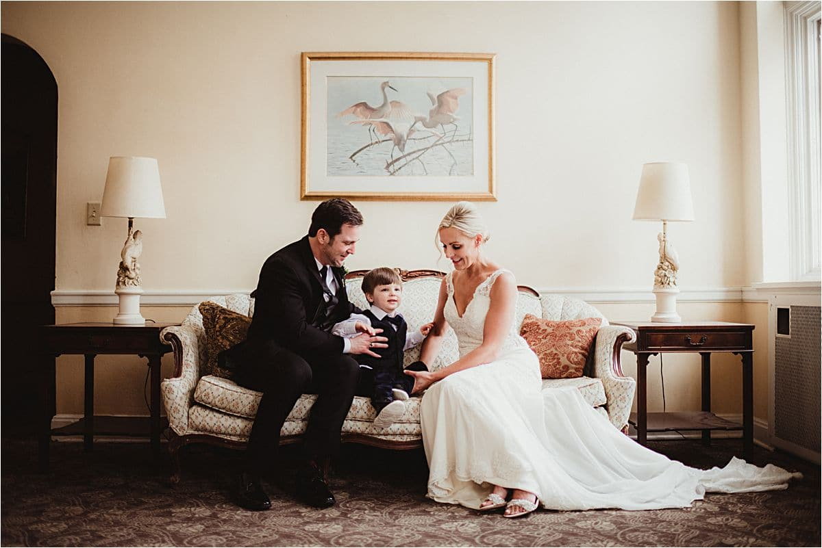 Bride and Groom Sitting with Son