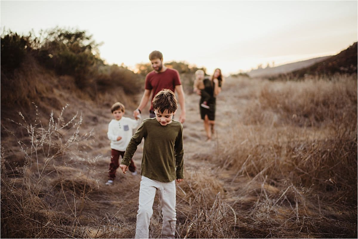 Boy Leading Family on Walk
