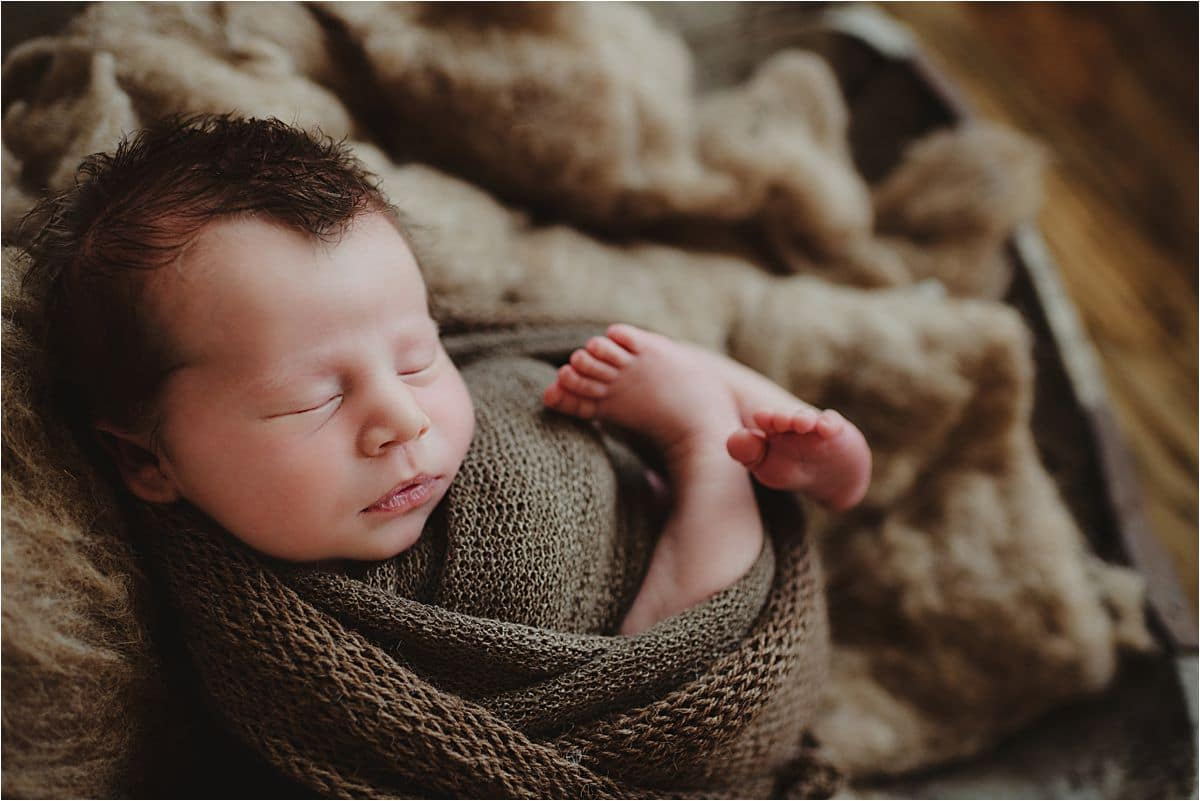 Newborn Boy Wrapped in Brown