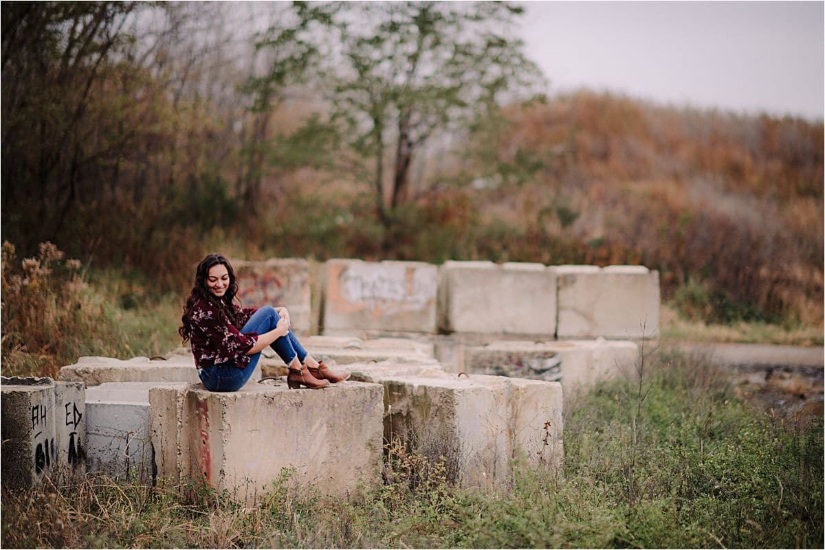 Senior Girl Sitting on Concrete