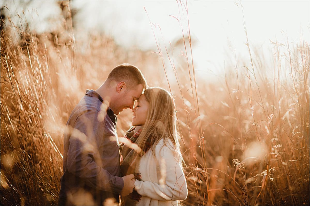 Couple Touching Foreheads in Field