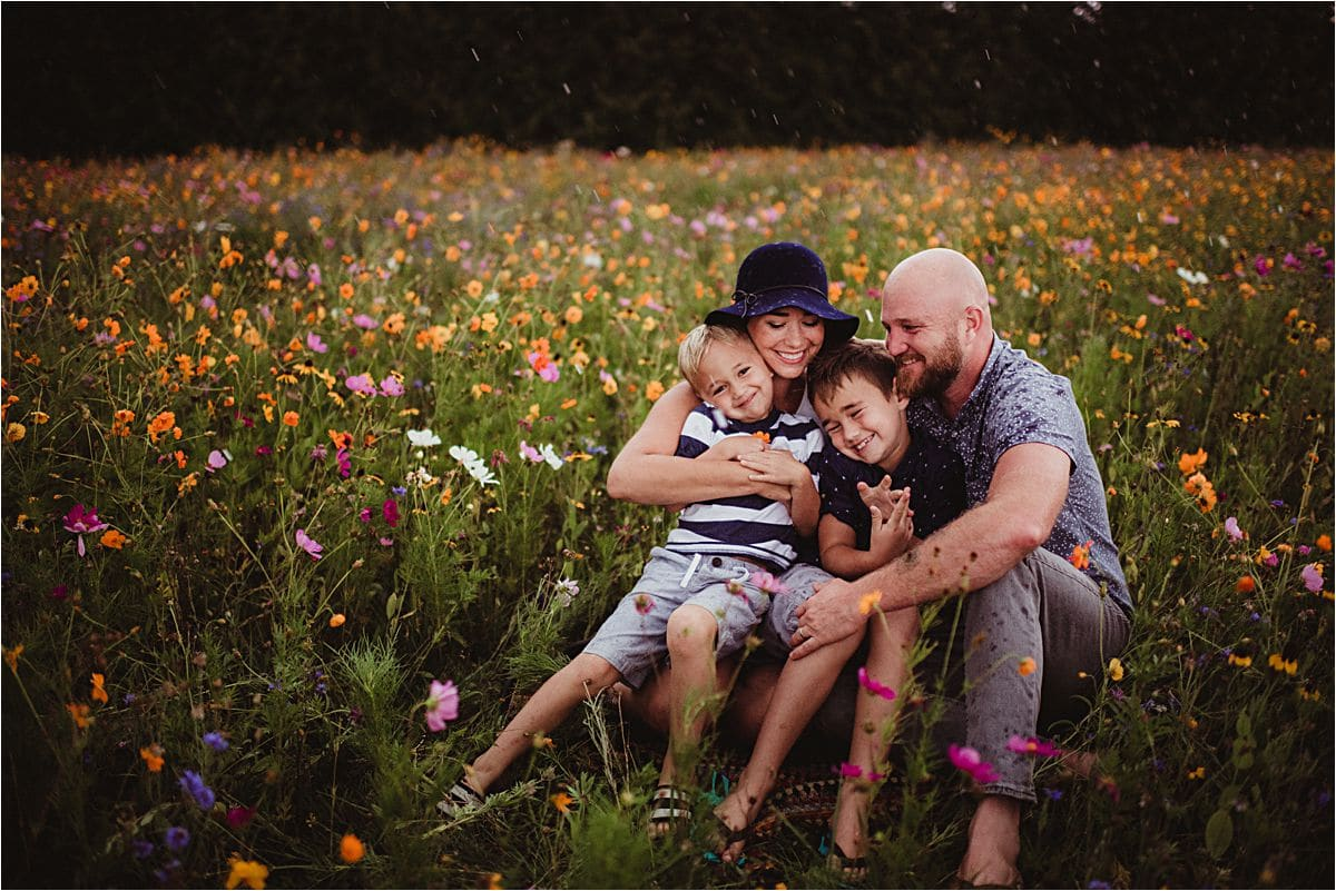 Wildflower Meadow Family Session Family Hugging