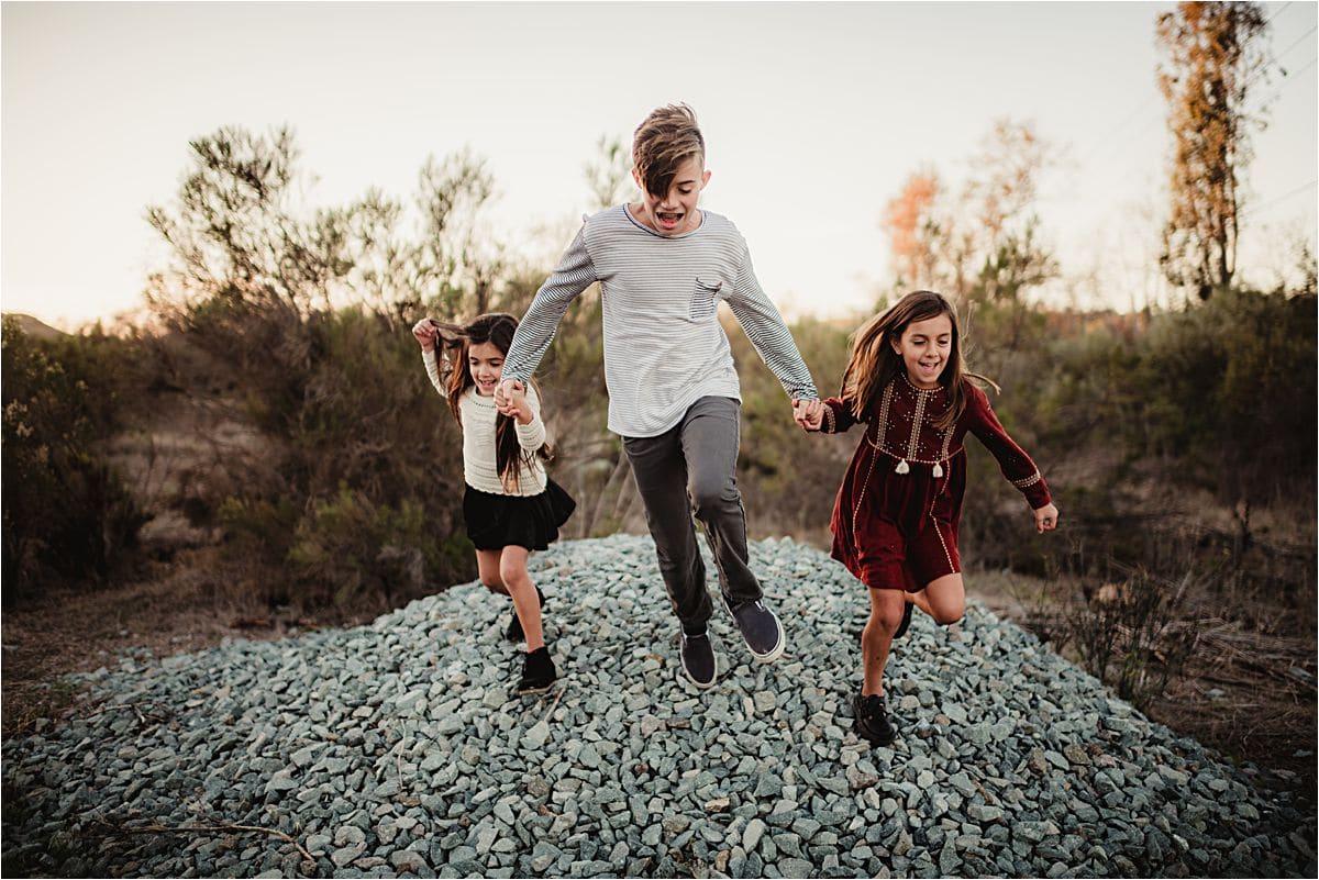 Kids Jumping Off Rock Pile