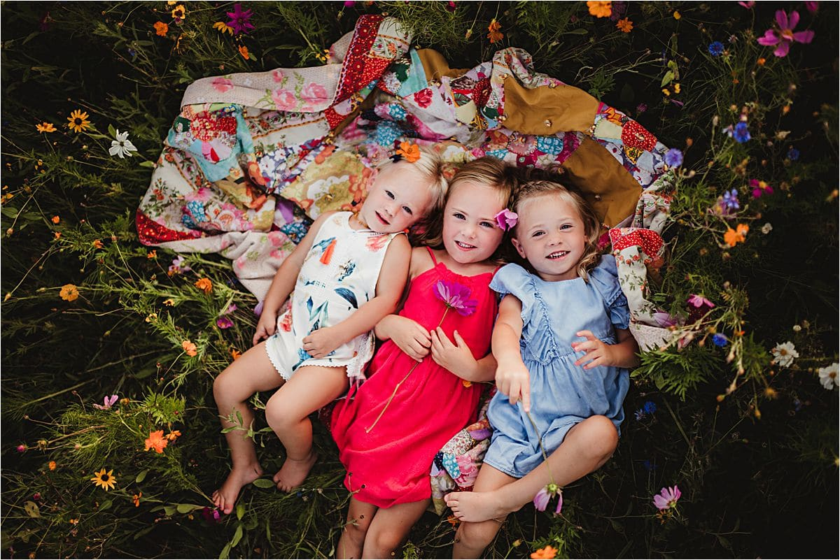 Outdoor Sisters Family Session Sisters on Quilt
