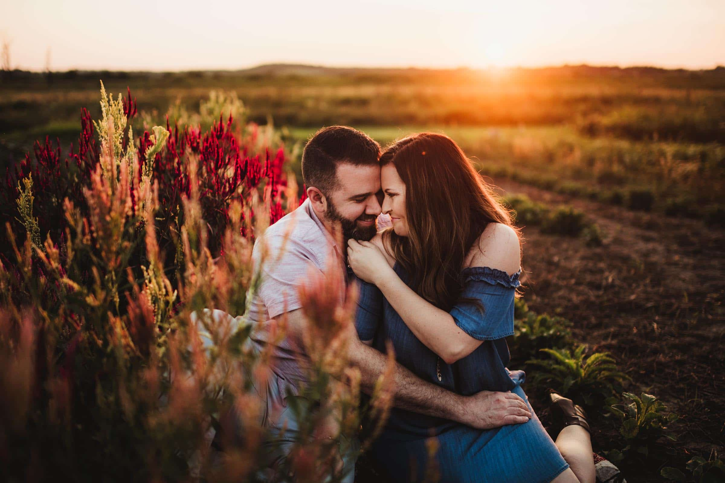 Couple Snuggling Flower Field at Sunset