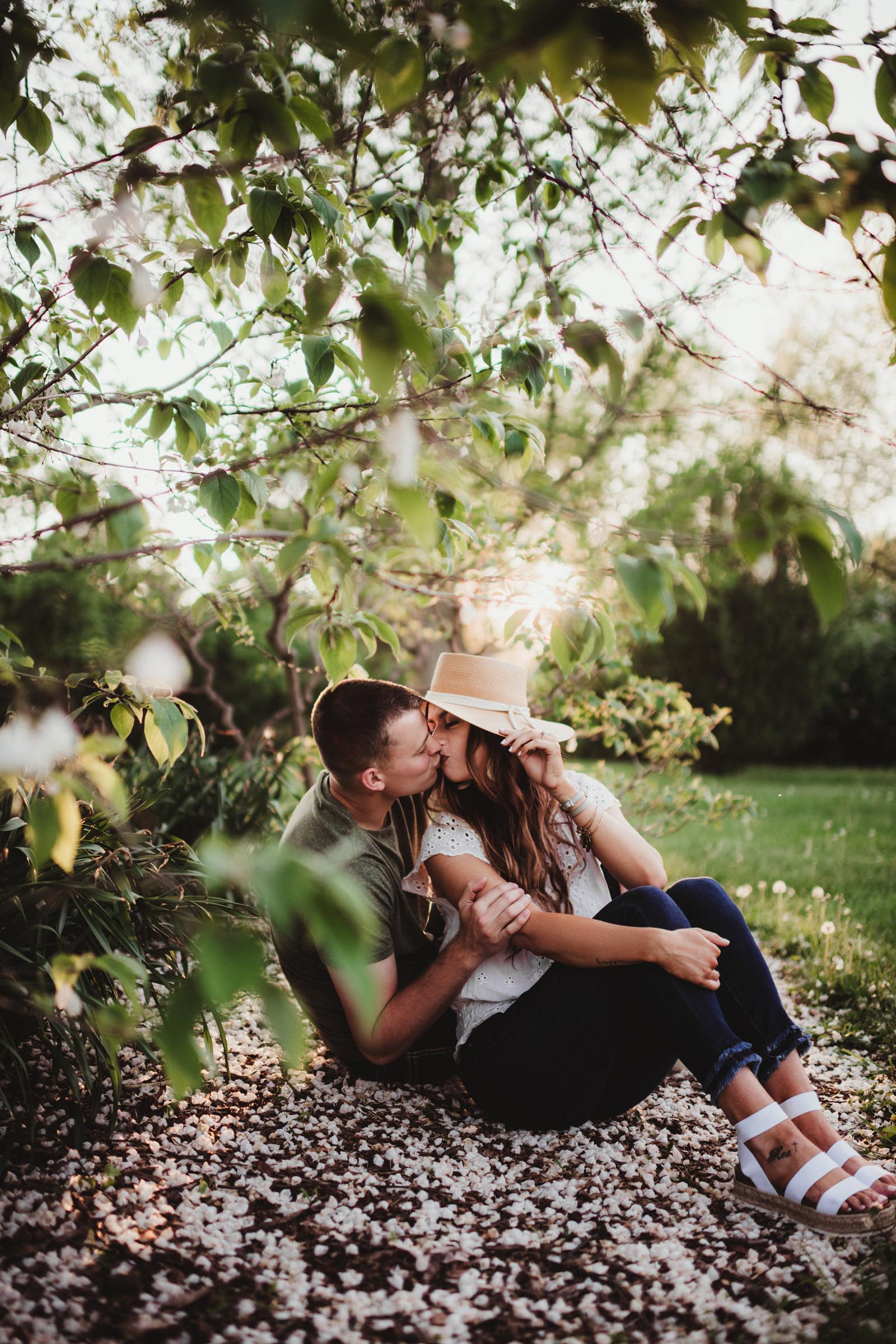 Couple Sitting Under Tree Kissing