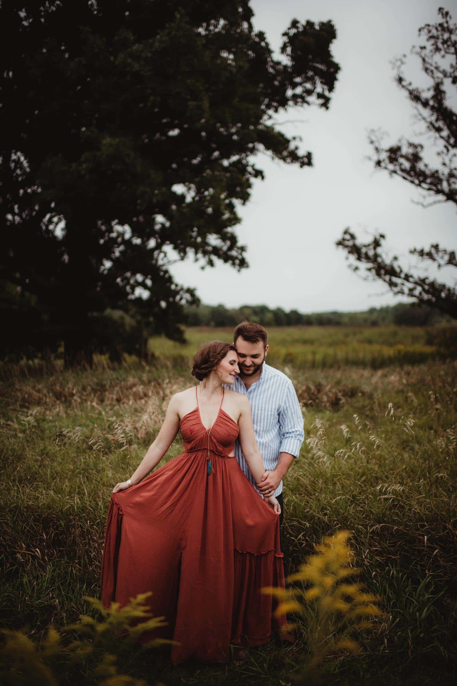 Couple in Field Woman in Rust Colored Dress