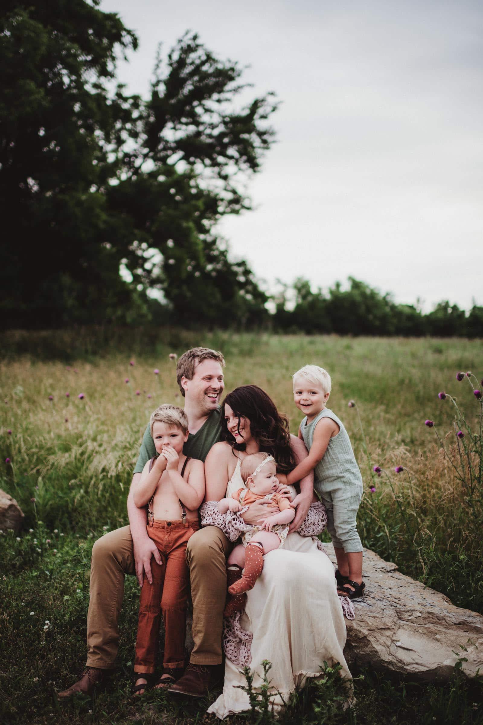 Family on Rock in Field