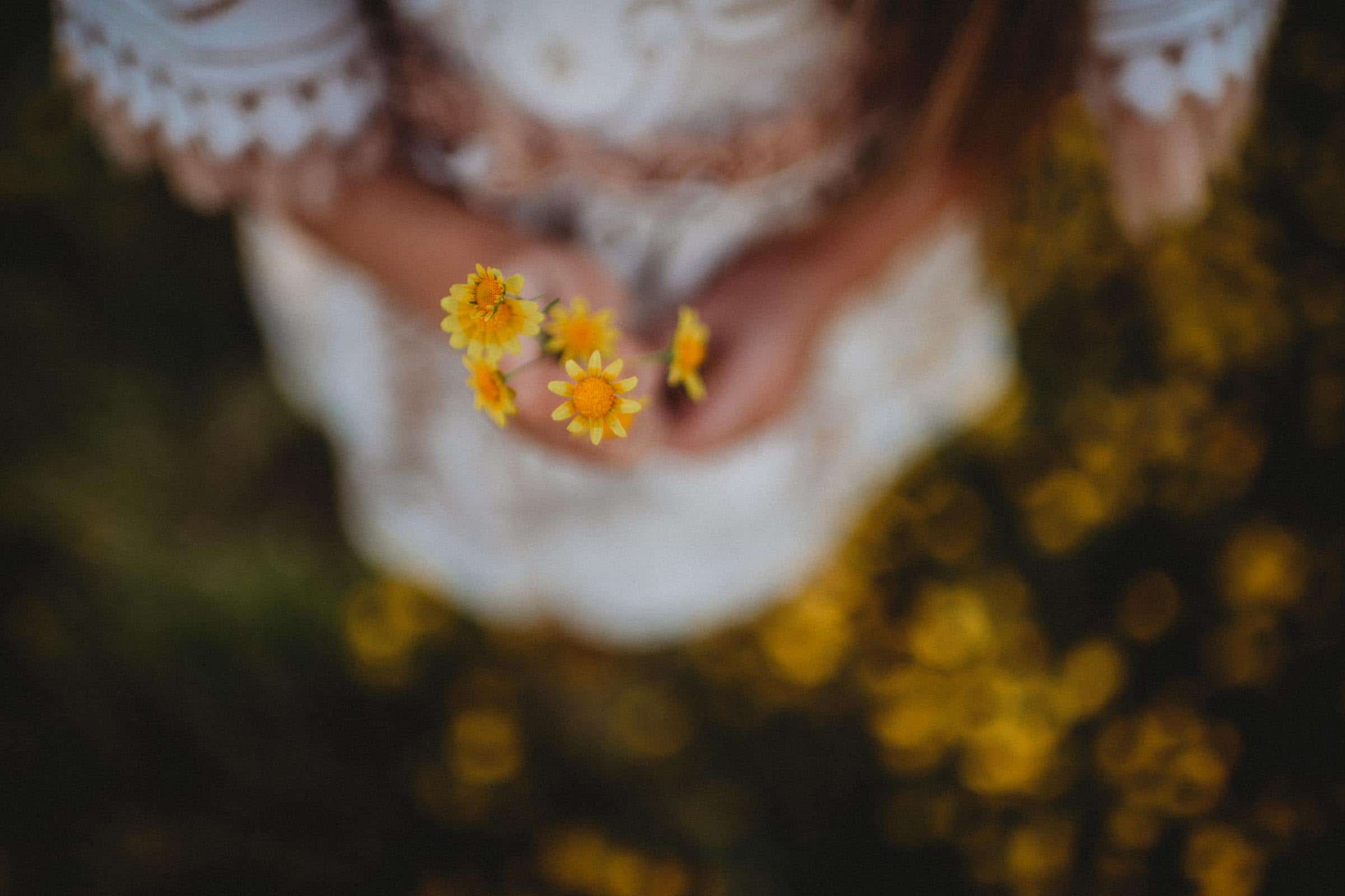 Close Up Little Girl Holding Yellow Flowers