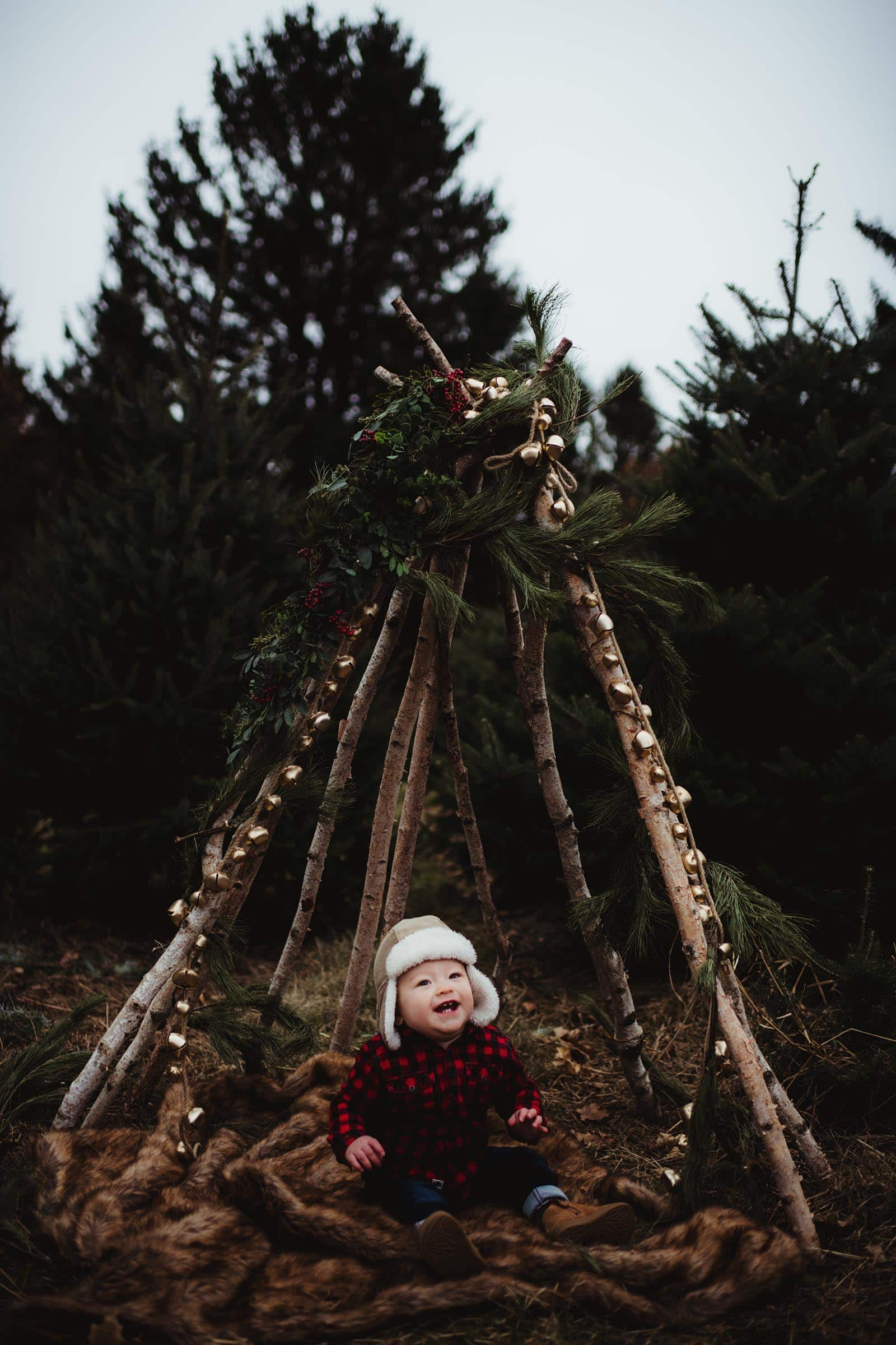 Baby in Wood TeePee