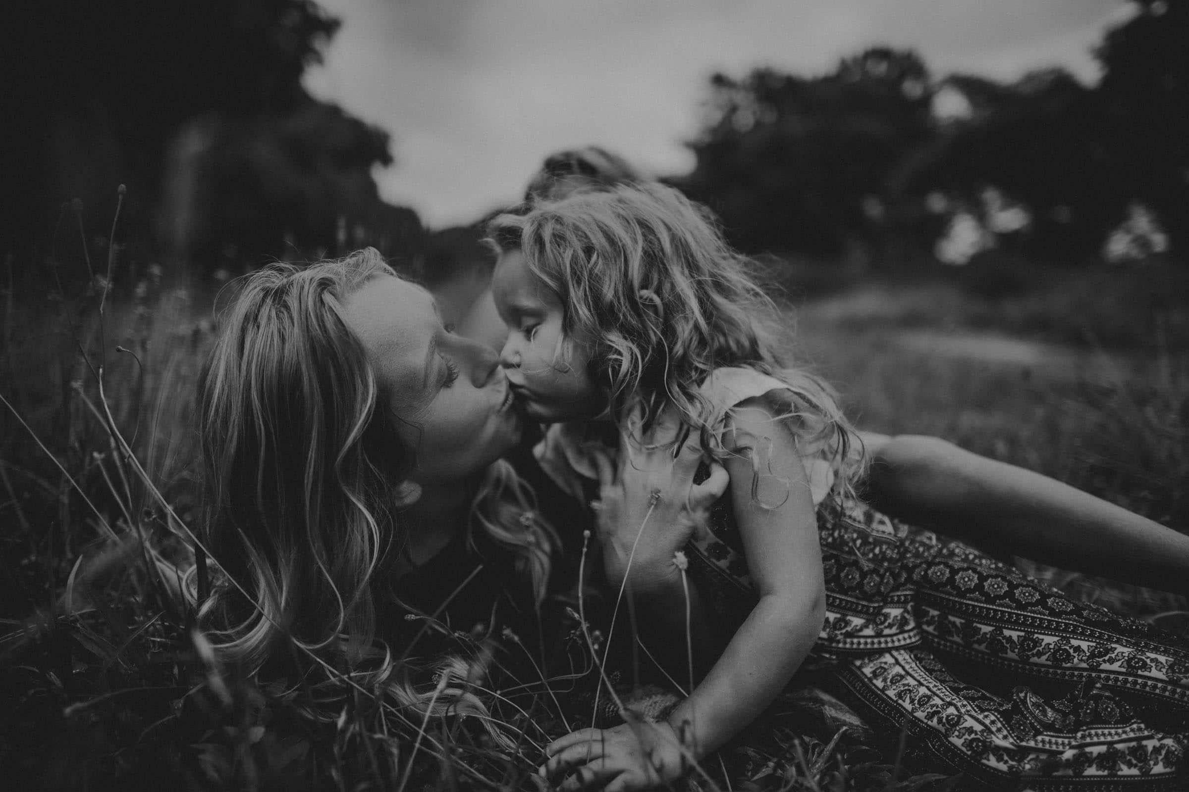 Black and White Image Mom and Daughter Kissing