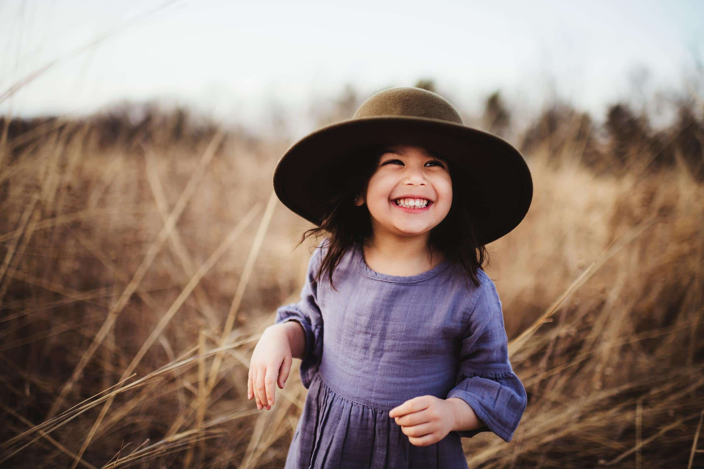 Little Girl in Hat Smiling