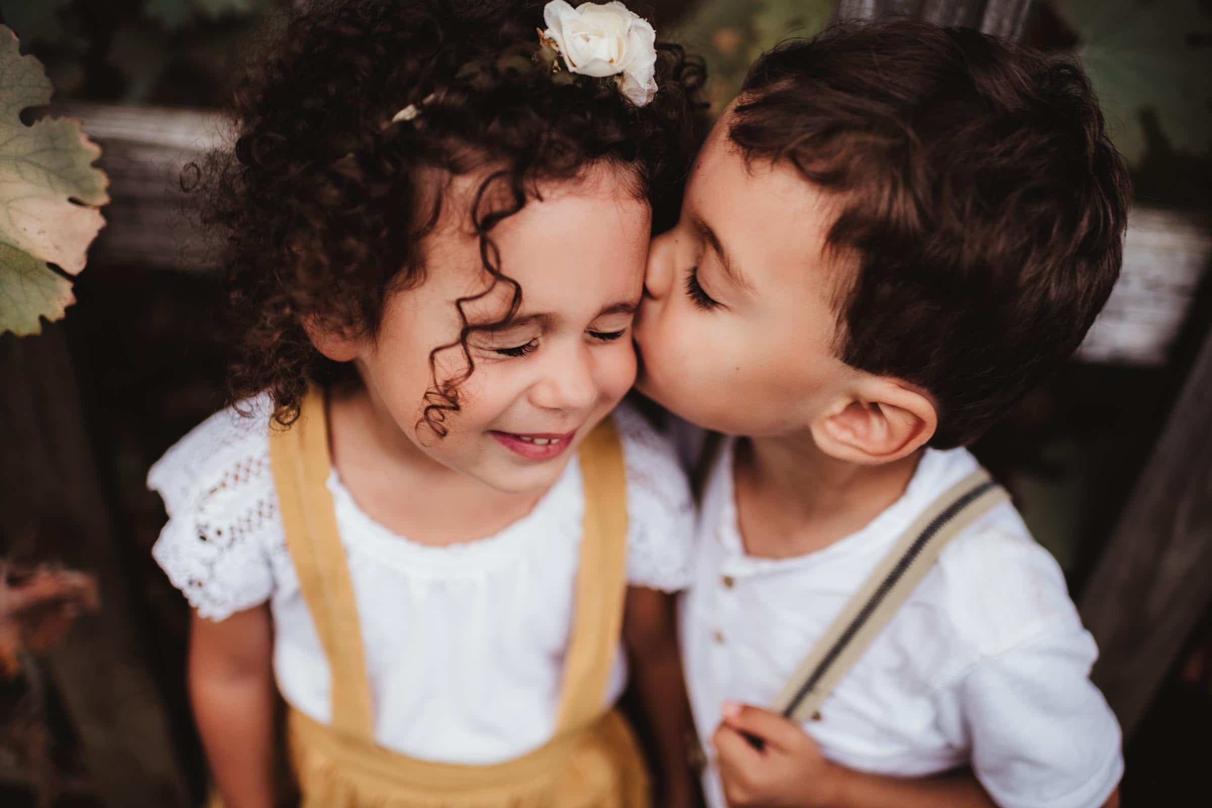 Brother Kissing Sister's Cheek