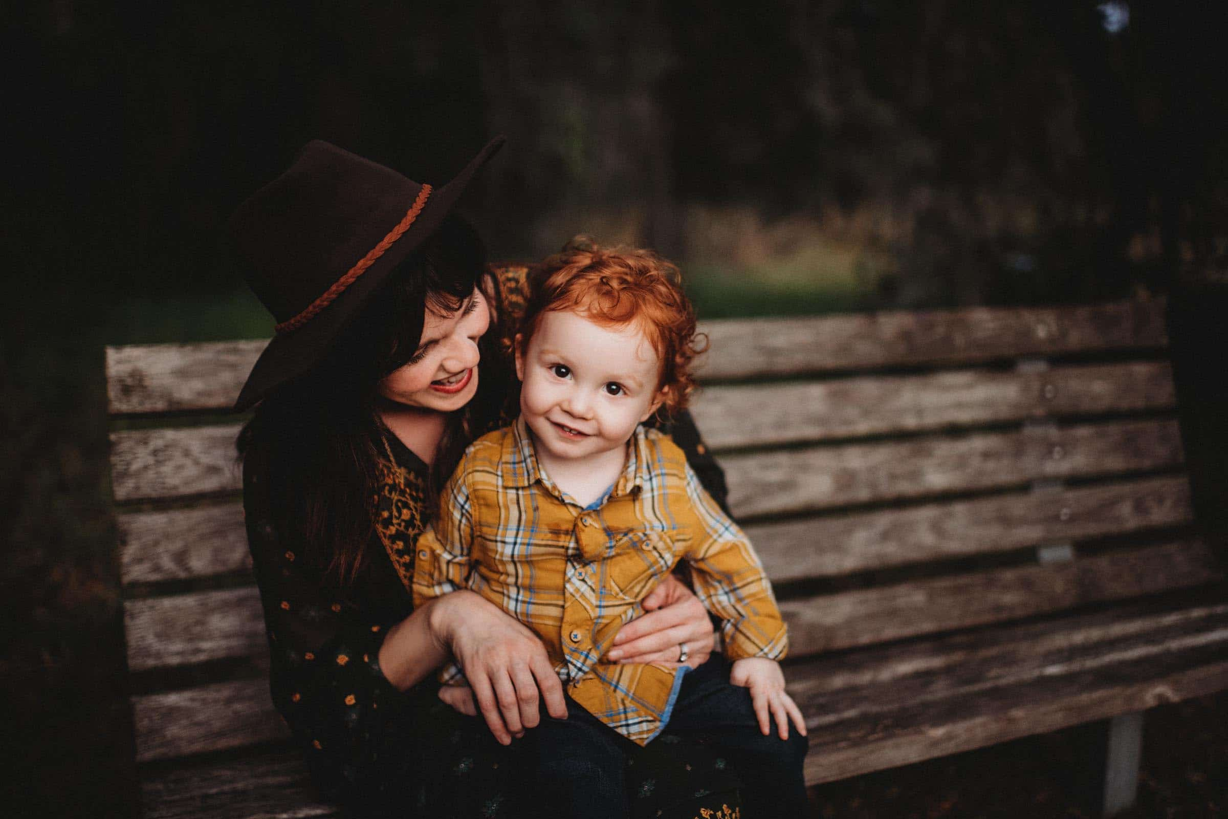 Little Boy Red Hair Sitting on Mom's Lap