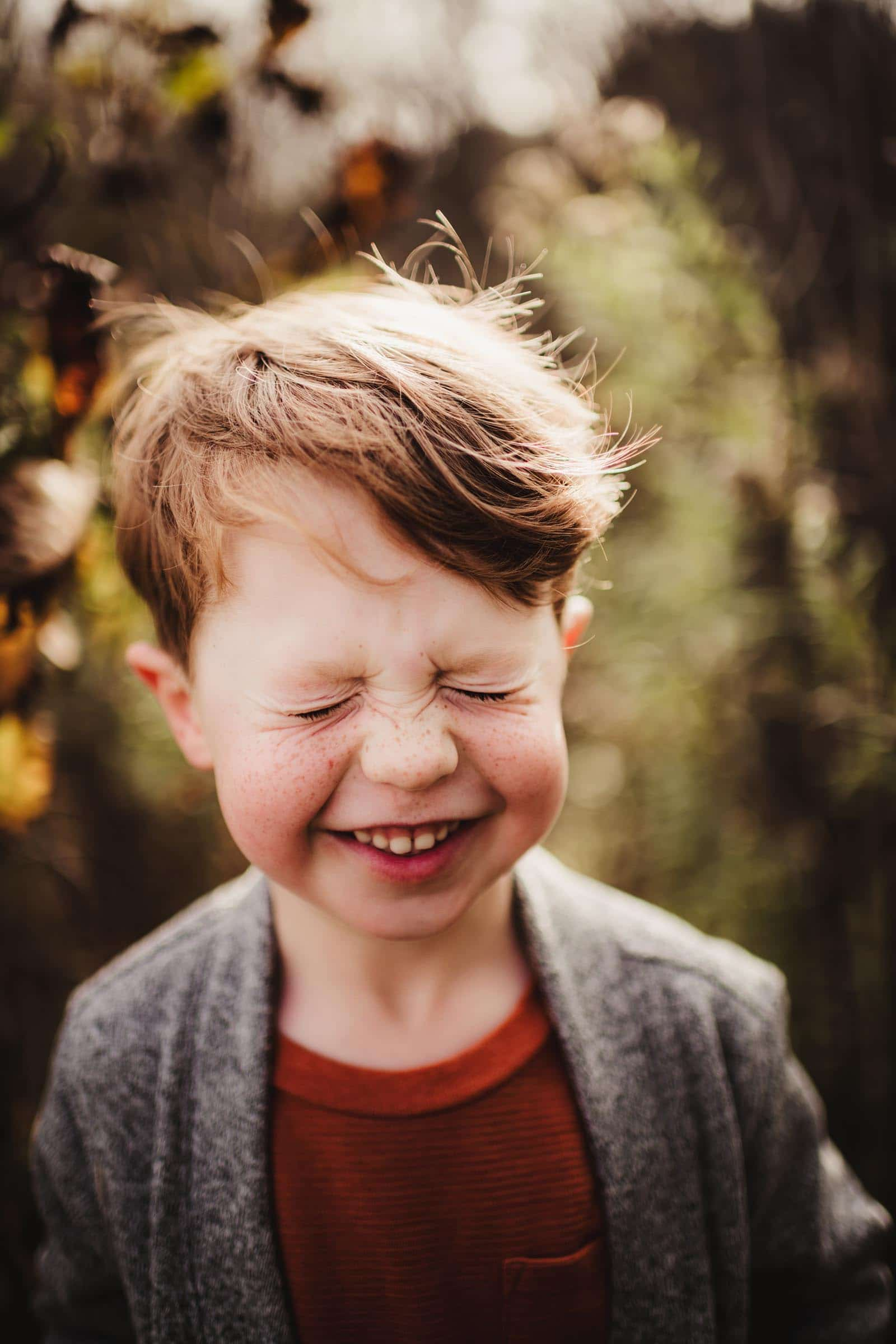Close Up Little Boy Face Scrunched Laughing