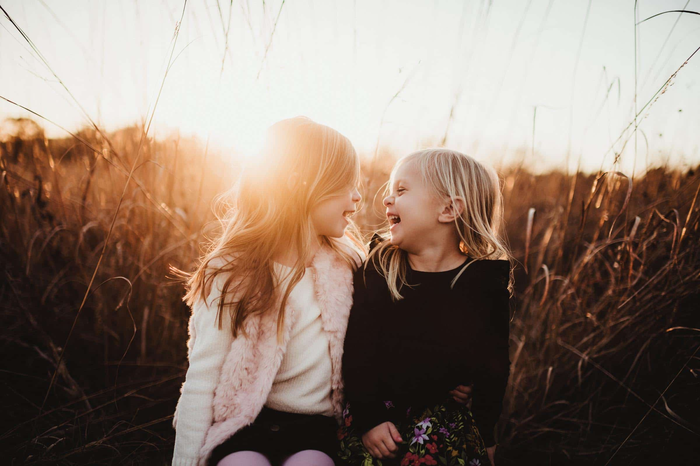 Sisters Laughing at Sunset
