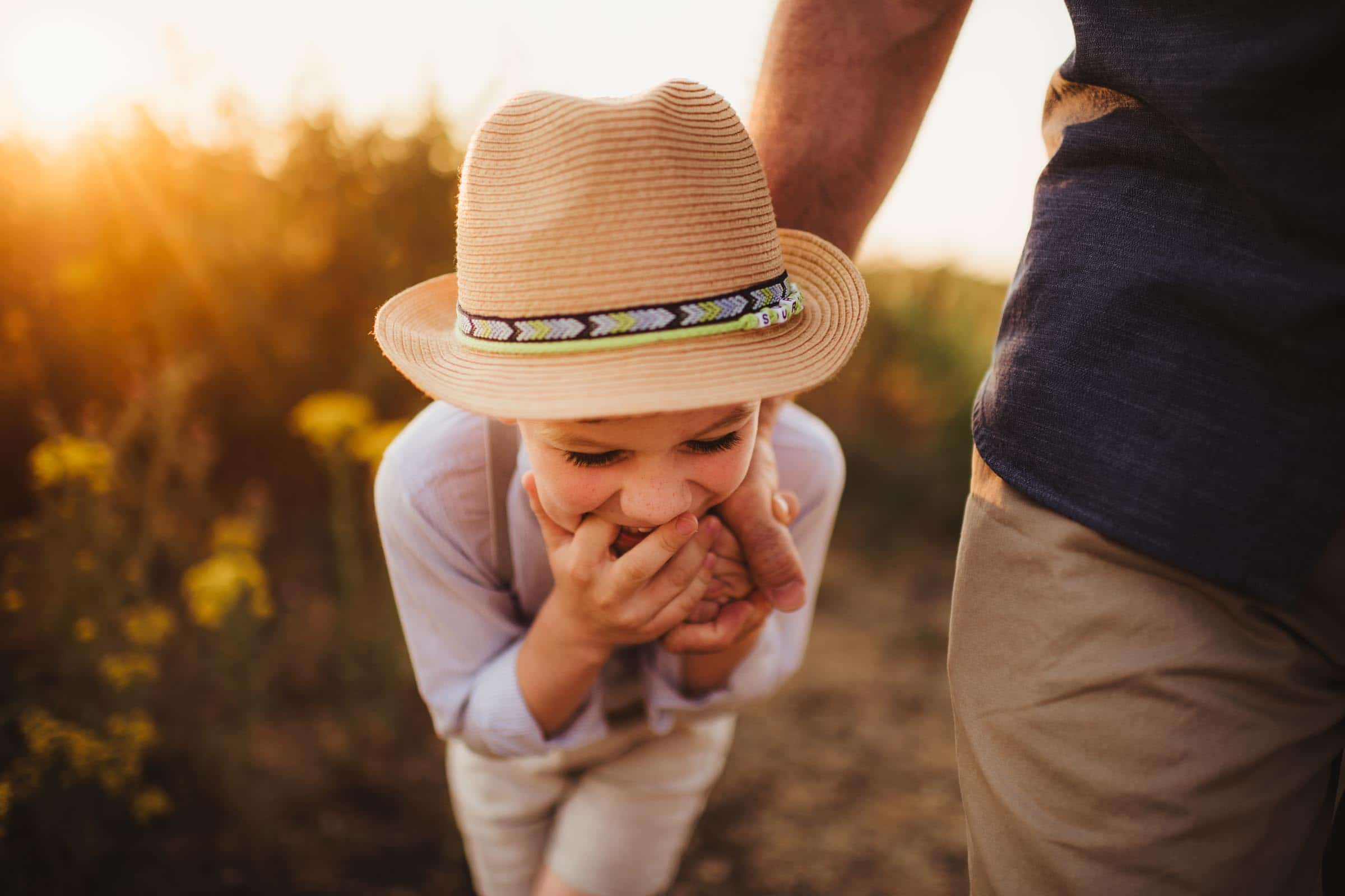 Little Boy in Hat Laughing
