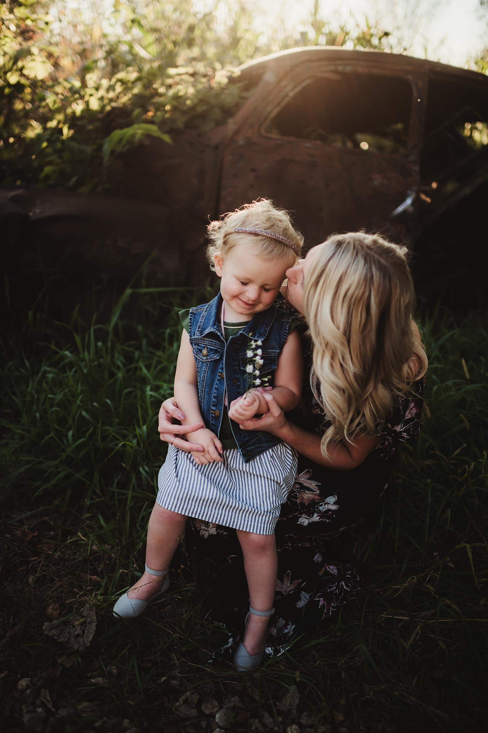 Mom Kissing Daughter on Cheek