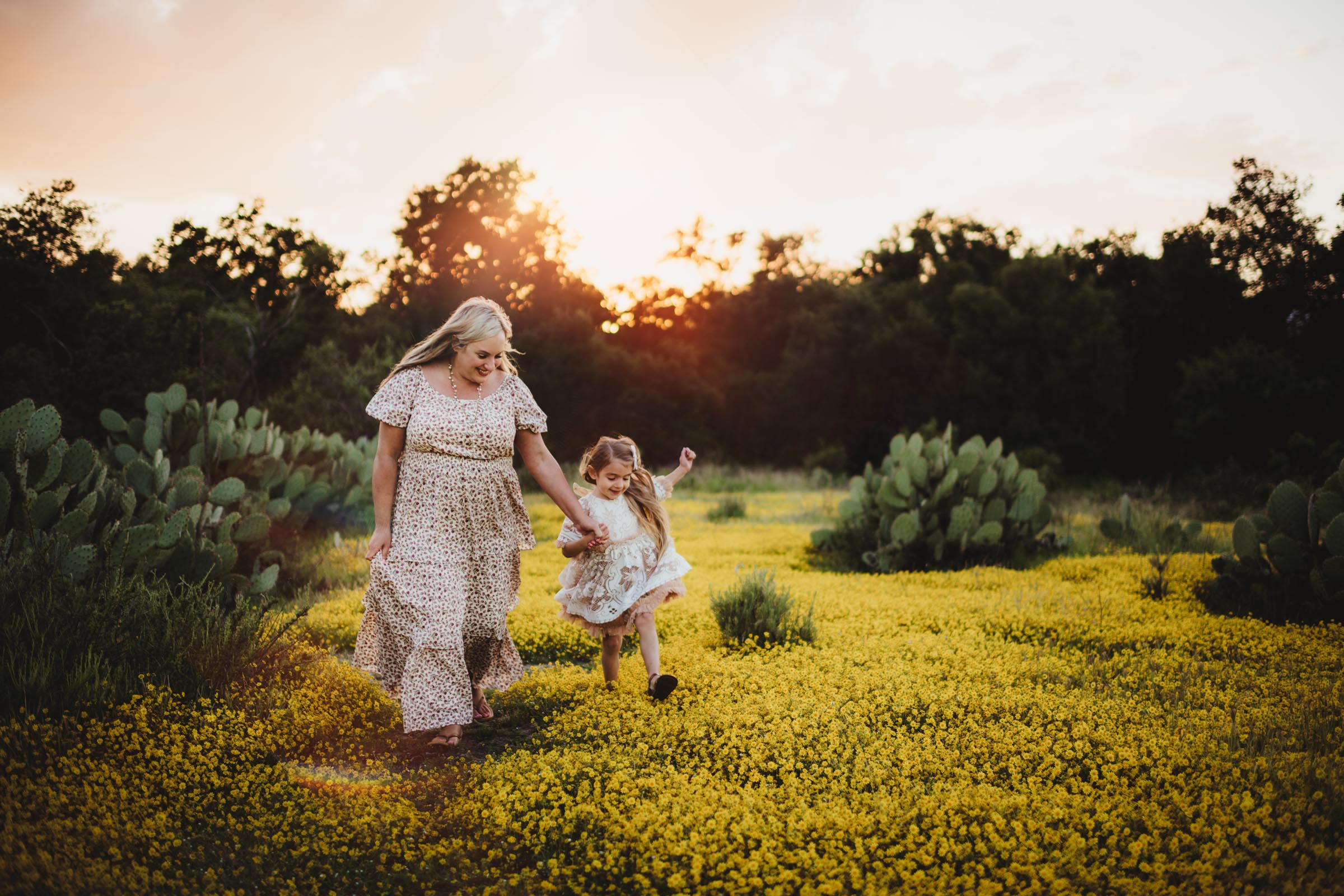 Mom and Daughter Running in Yellow Field