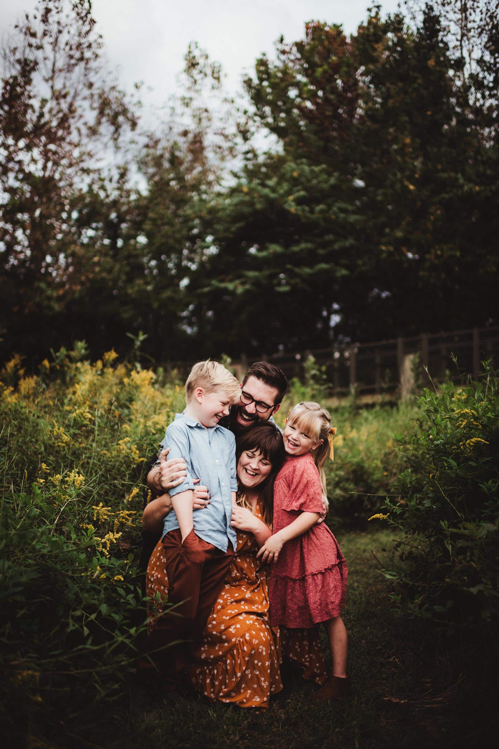 Parents Hugging Kids in Field