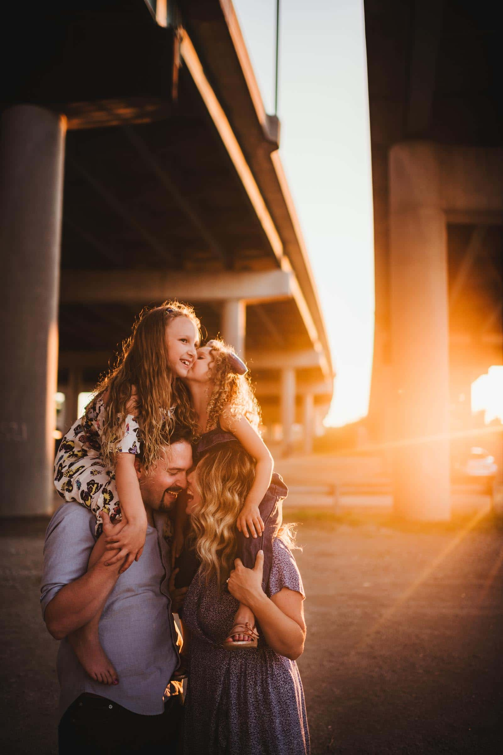 Family Under Highway at Sunset