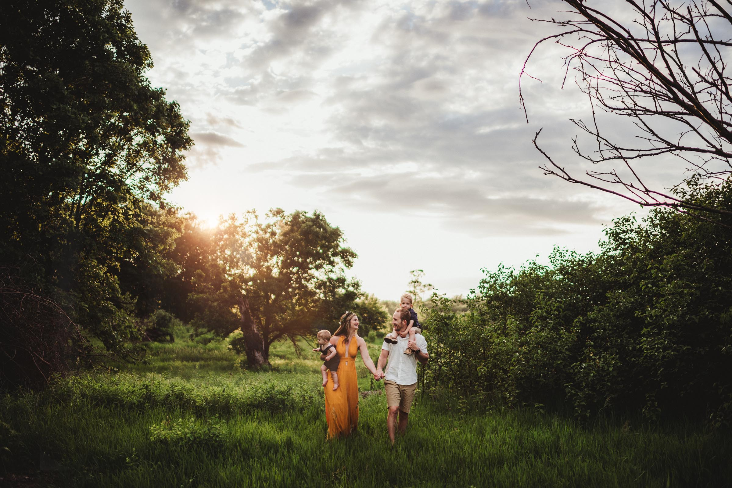 Family in Field at Sunset