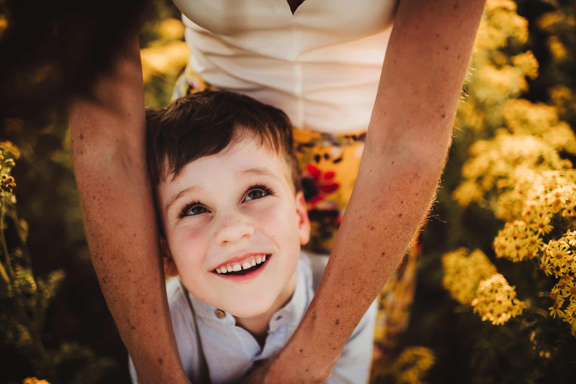 Boy Looking Up at Mom