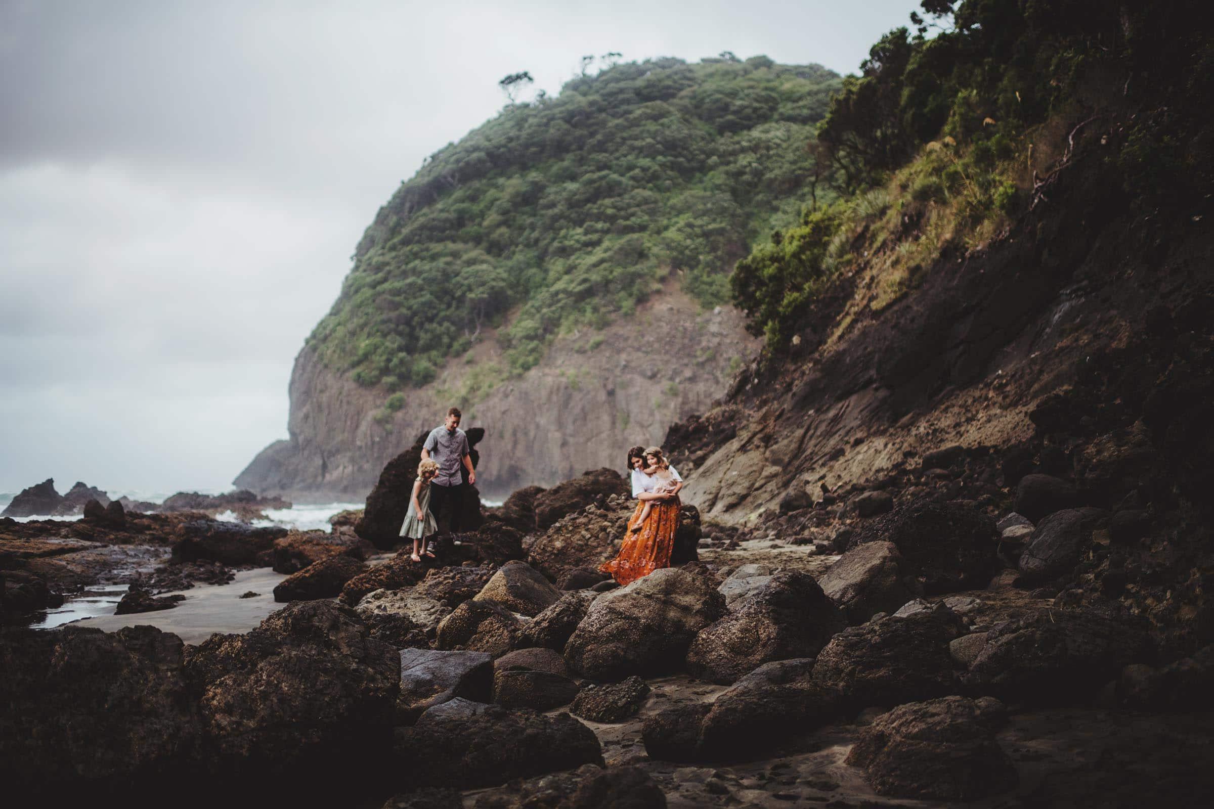Family Far Away on Cliff Near Water