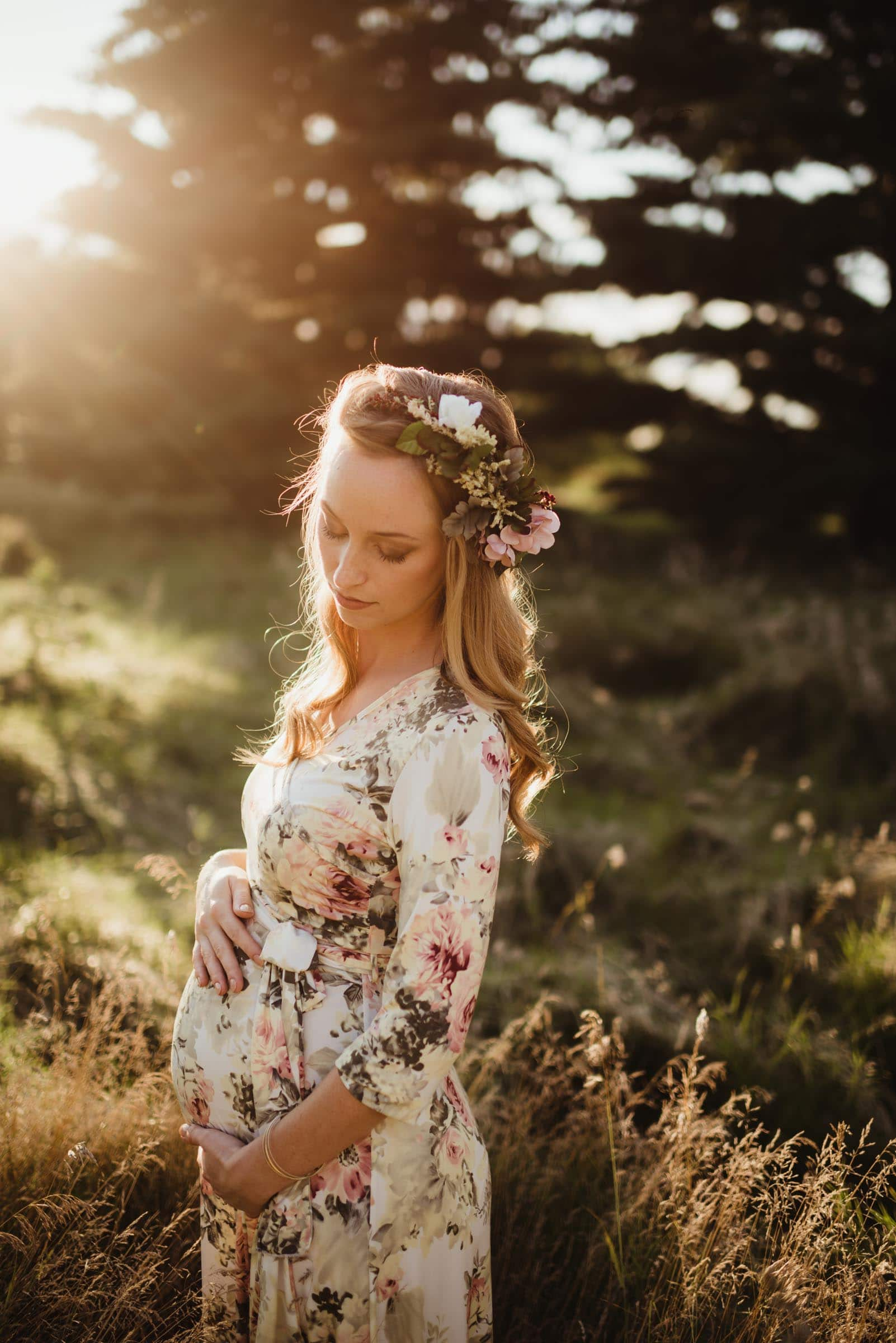 Pregnant Woman in Floral Crown at Sunset