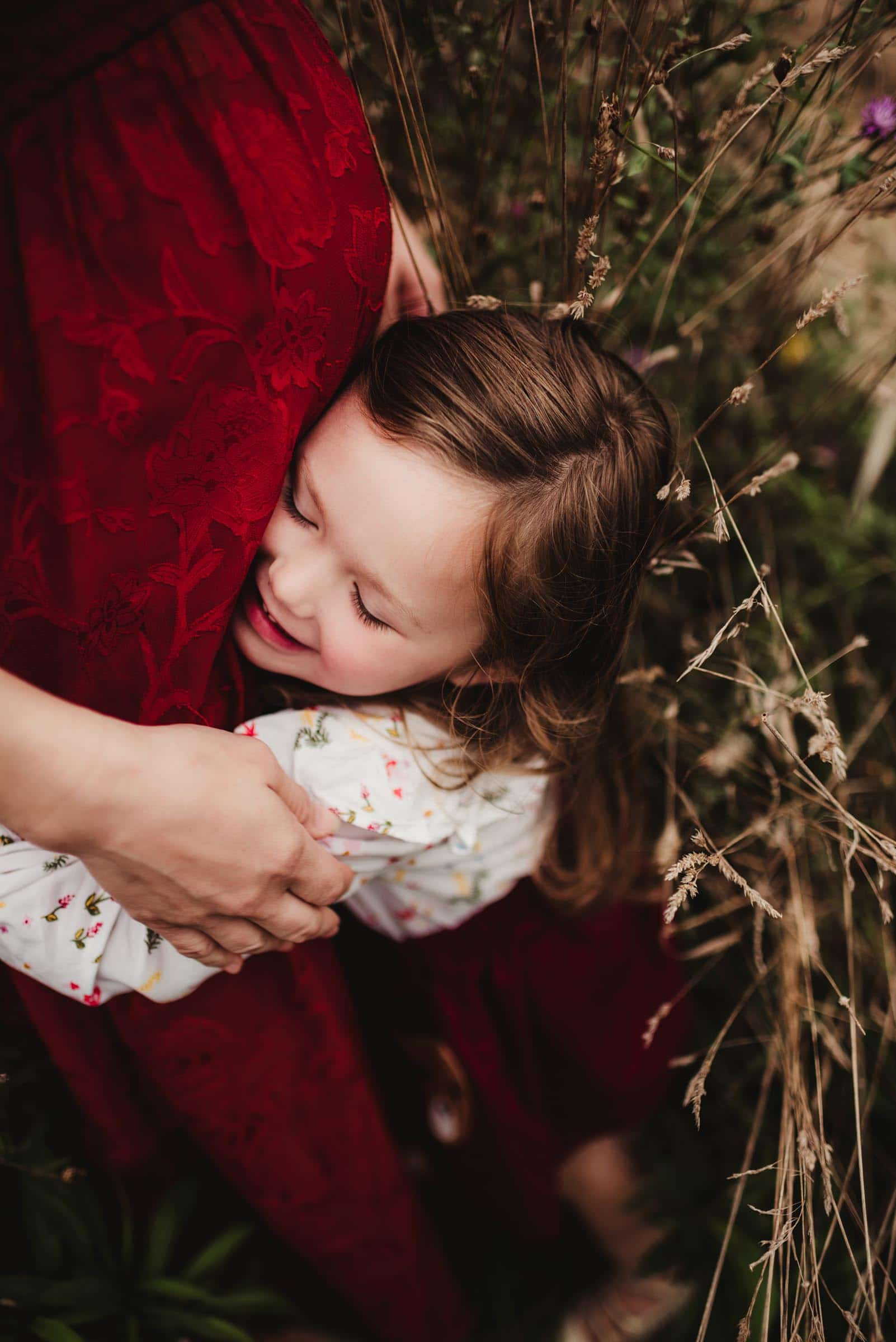 Little Girl Hugging Mom's Baby Belly