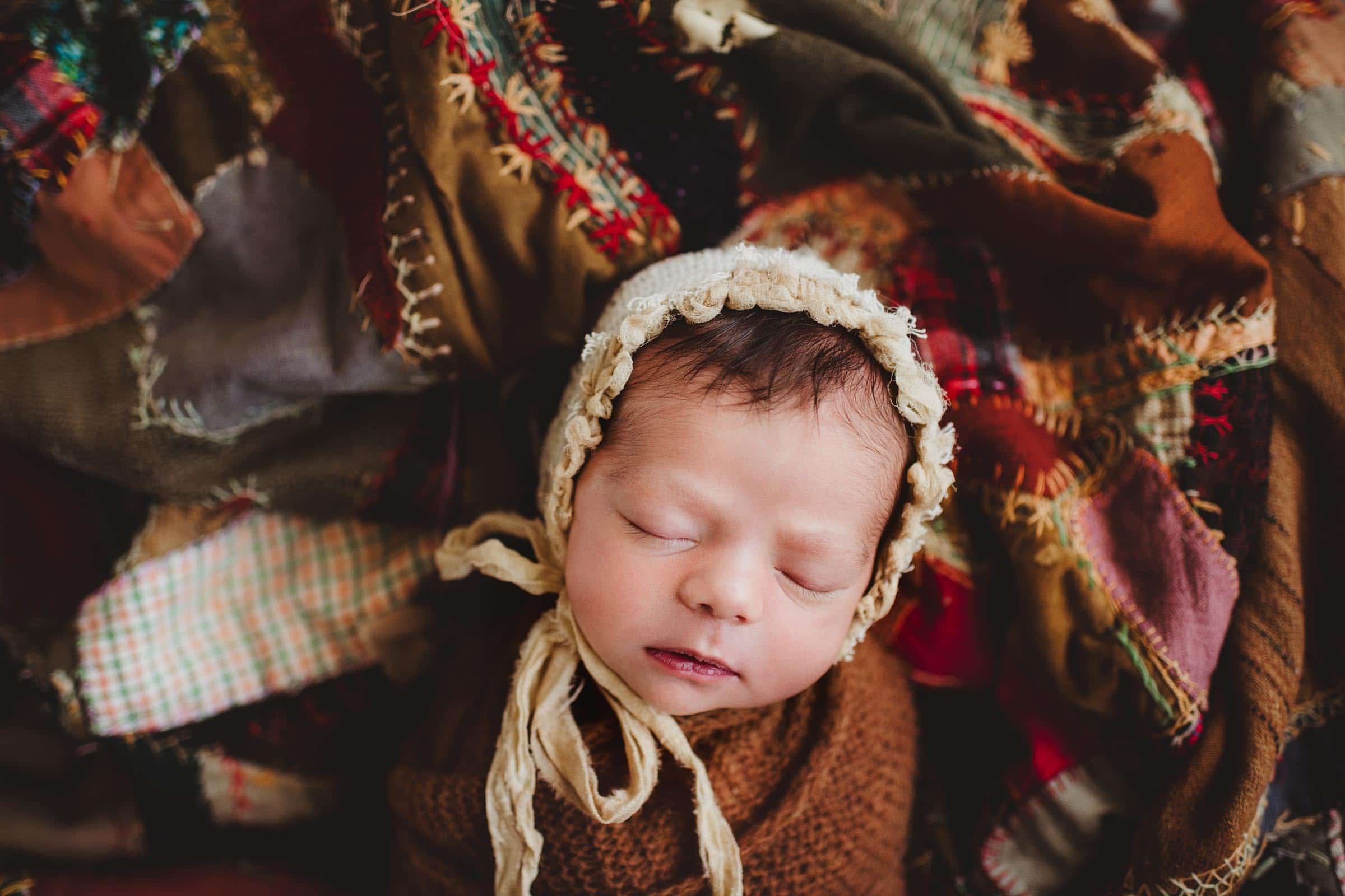 Newborn Girl in Lace Bonnet