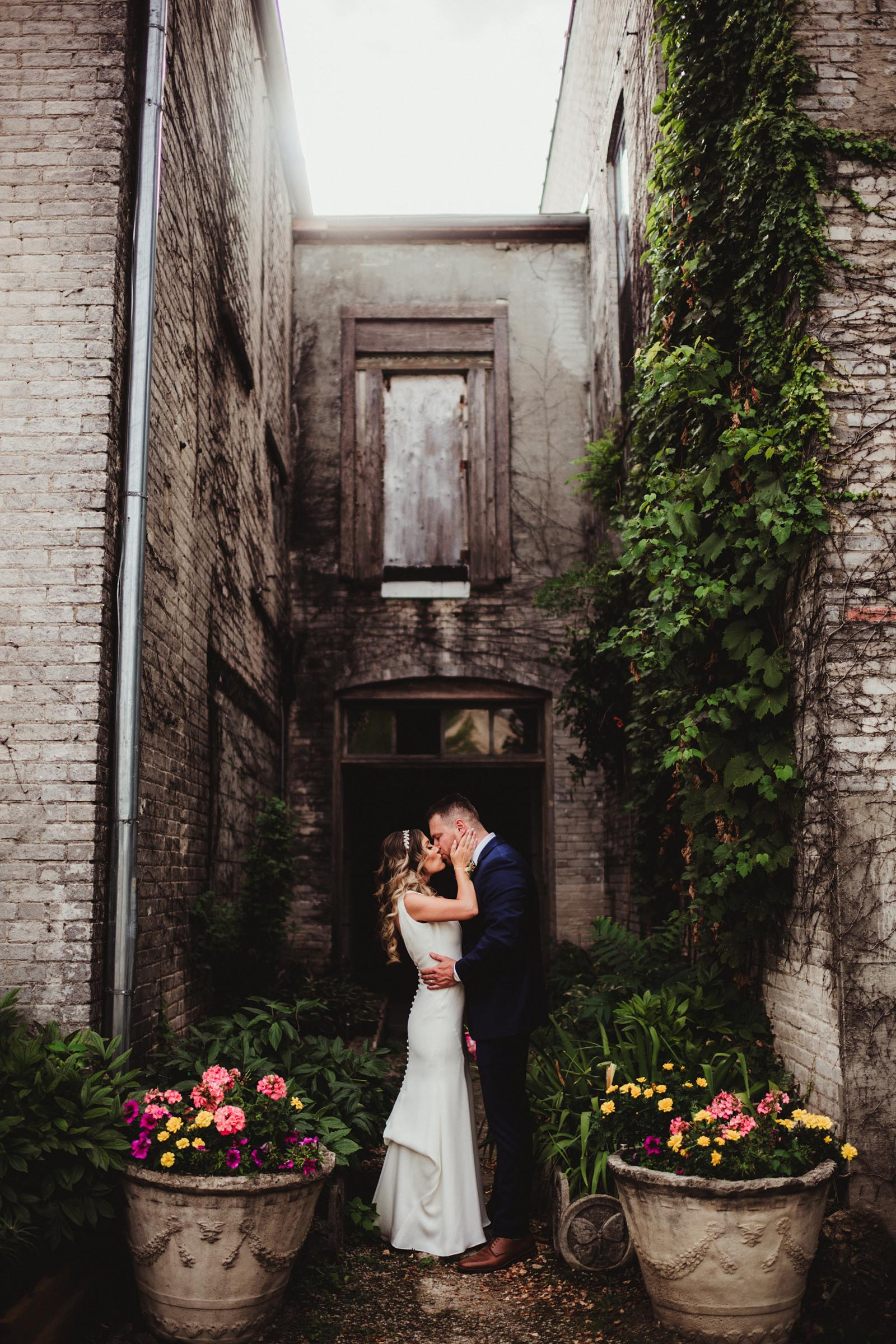 Bride Groom Kissing in Alley