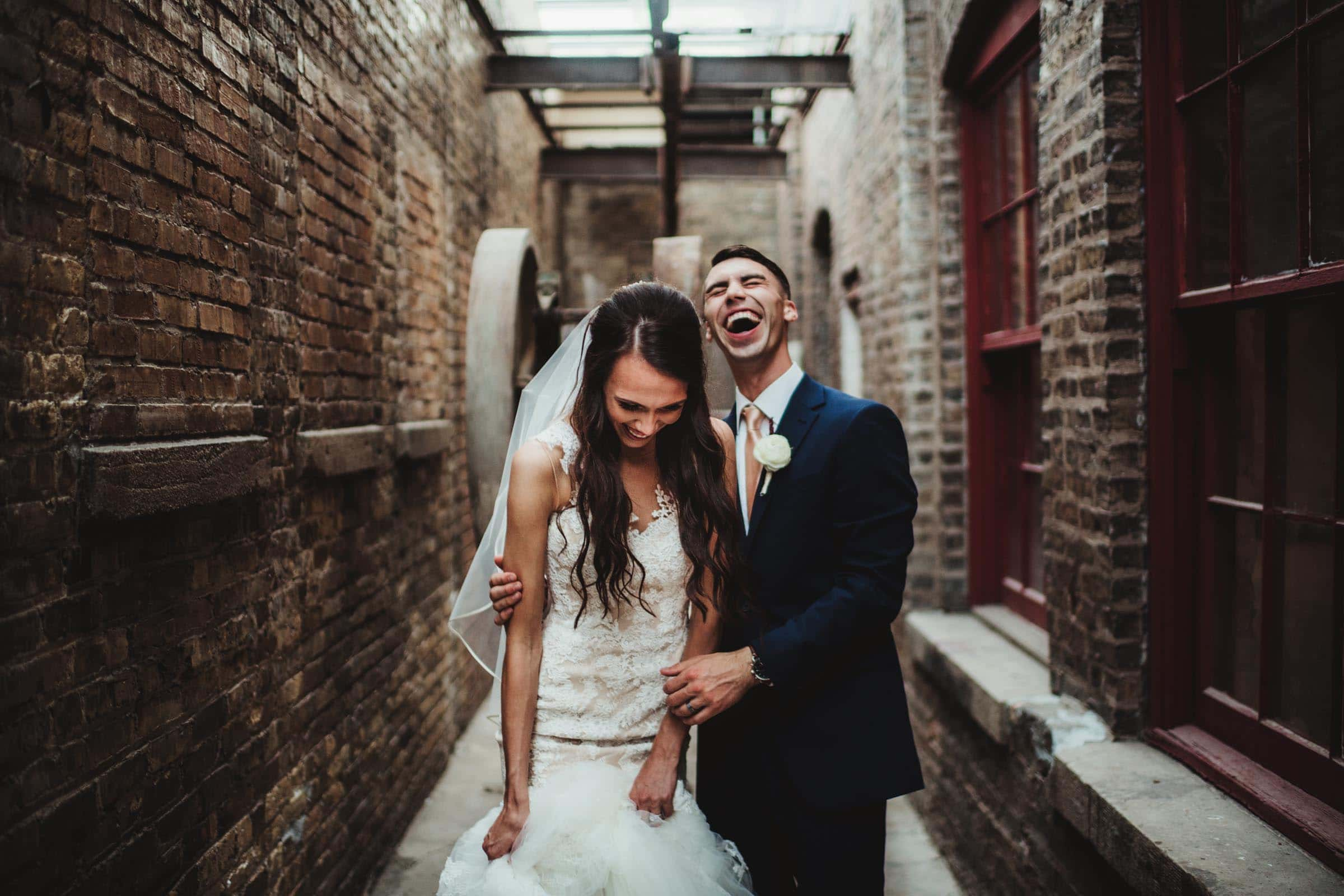 Bride Groom Laughing in Alley