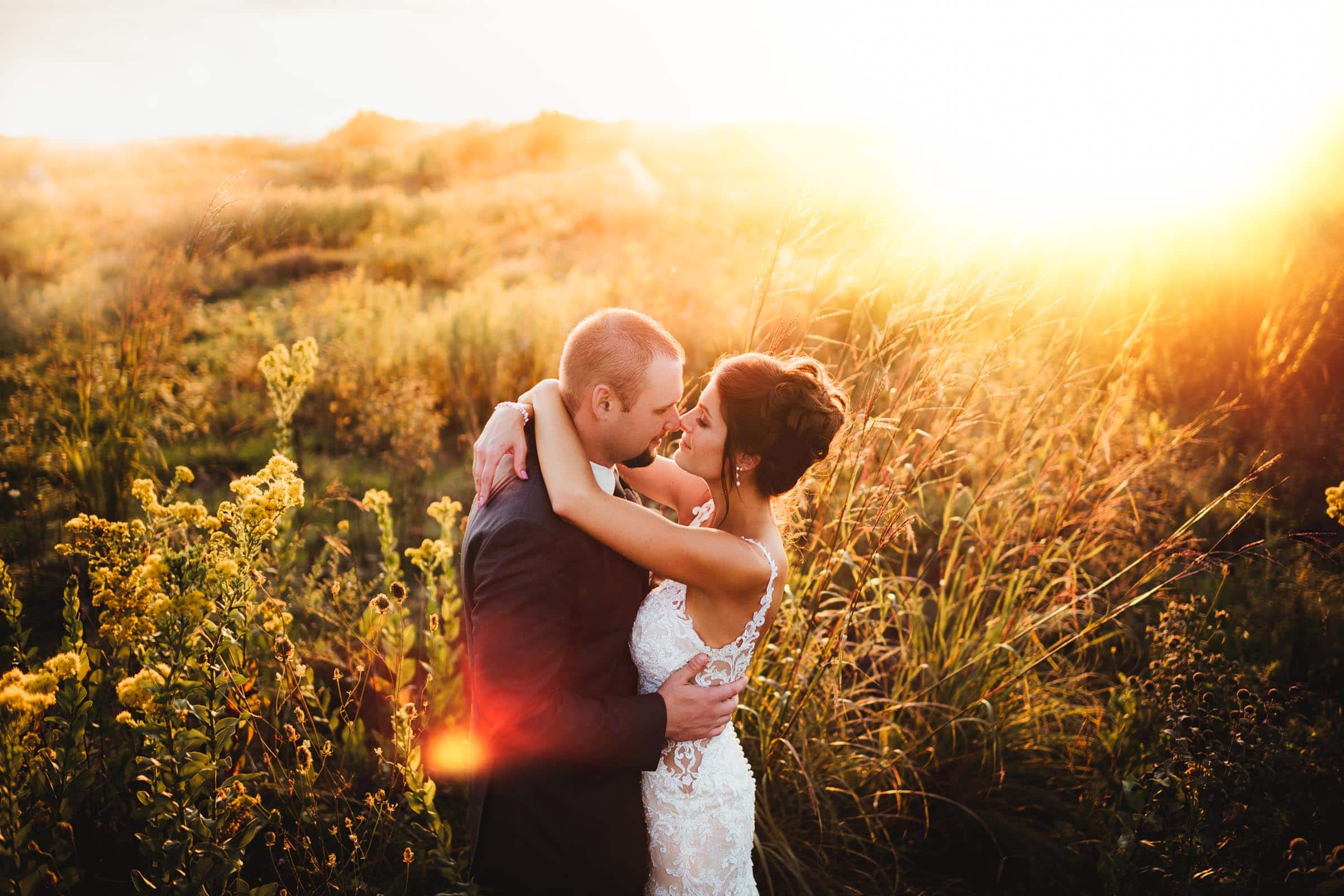 Bride Groom Kissing in Field